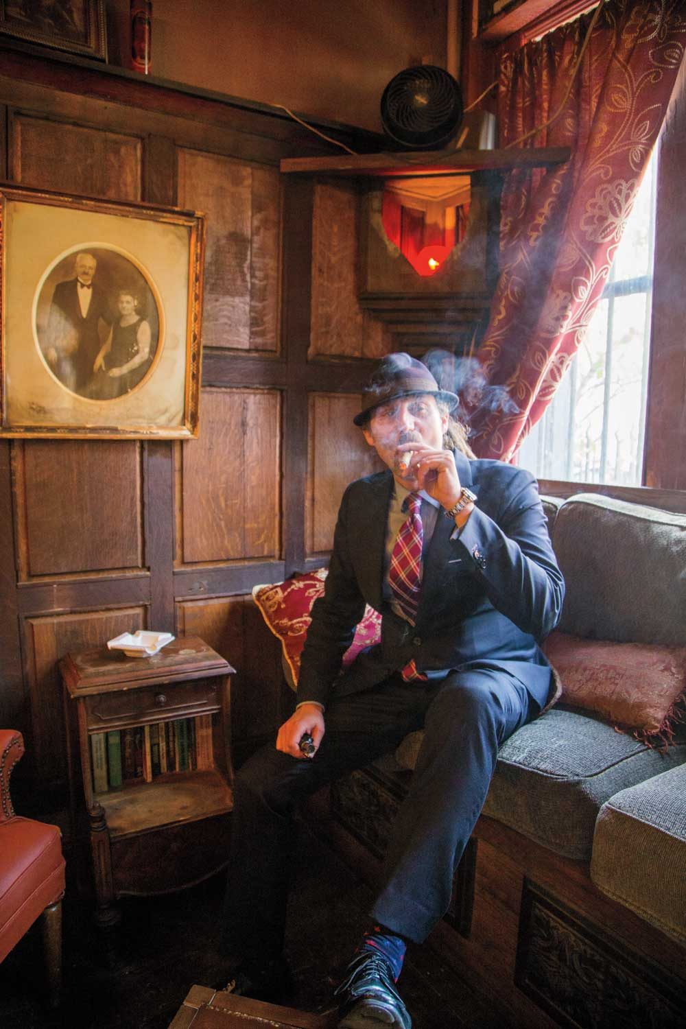 David Diamante lights up at his cigar lounge.