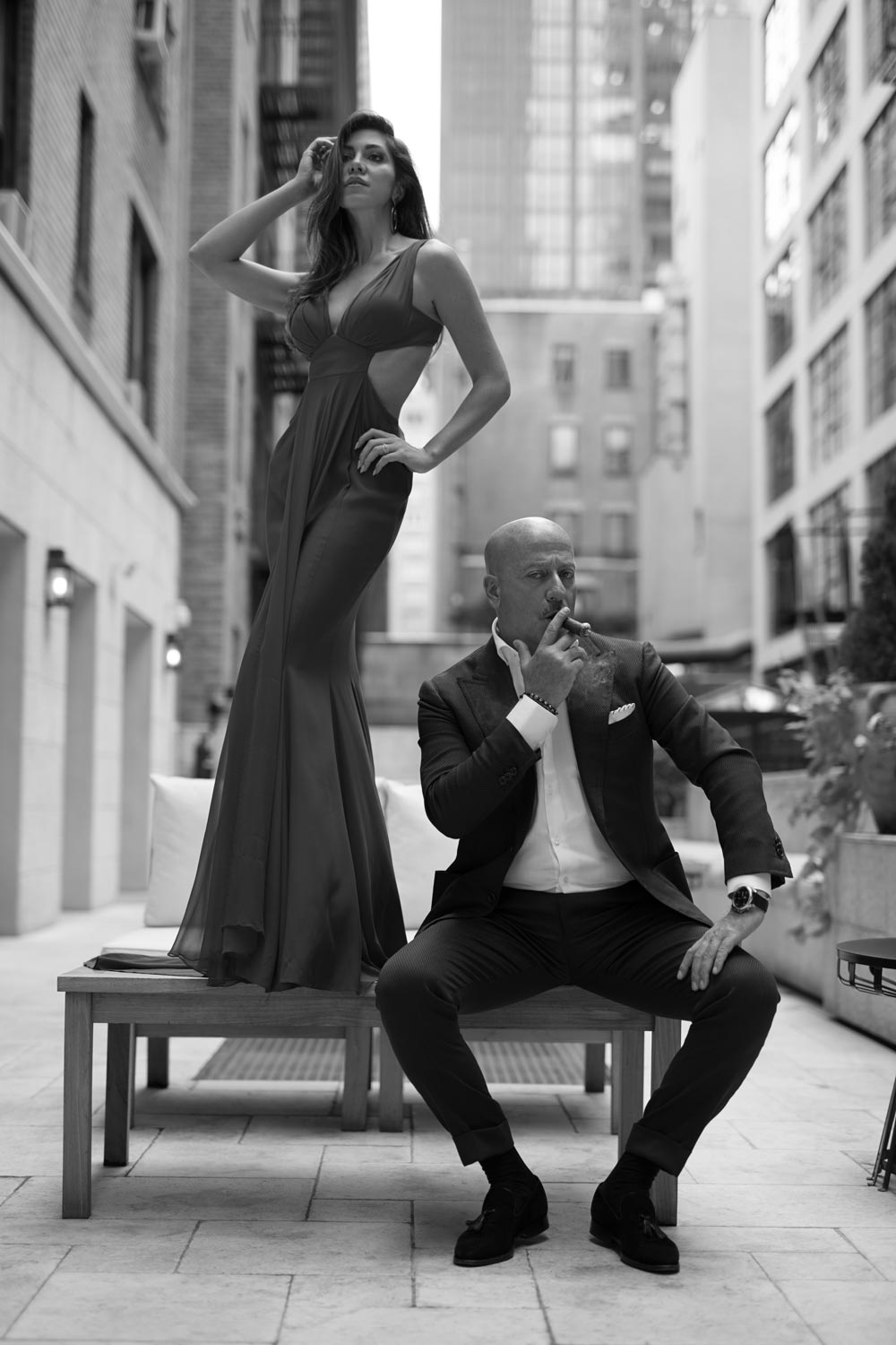 Domenico Vacca, smoking a cigar on the terrace at his Midtown Manhattan store, and his fiancée Eleonora Pieroni  (photo: Martin Crook)