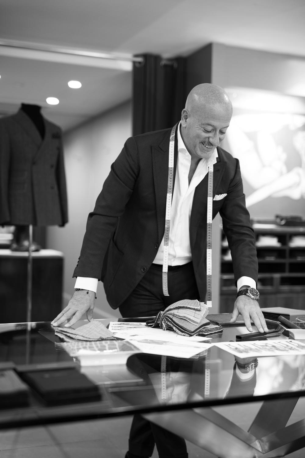 Domenico looks over sketches and swatches.  (photo: Martin Crook)