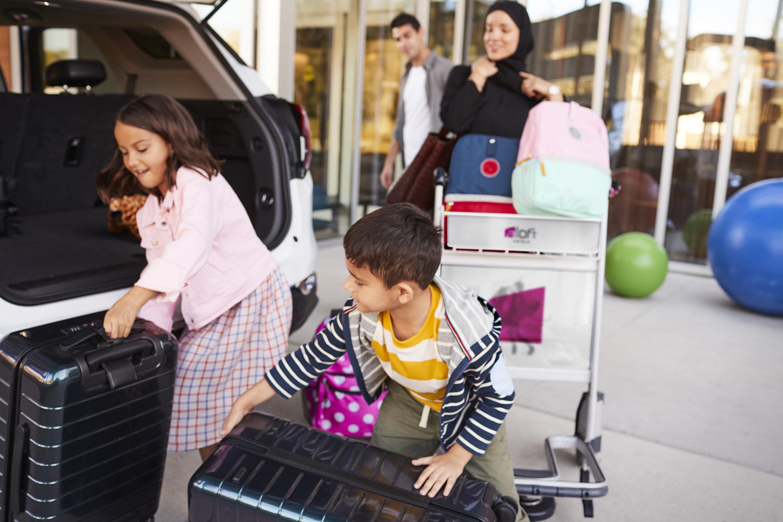 OUTSIDE_HOTEL_MEA_FAMILY_MOM_DAD_KID1_KID2_127_V6.jpg