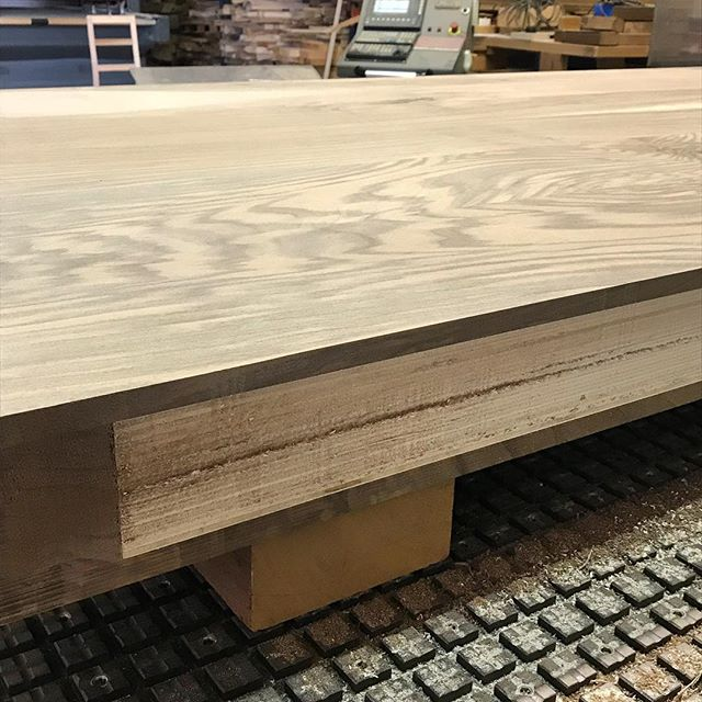 """Precision manufacturing of a 12'H x 7'W x 4""""T front door. Composed of 3""""T high quality white plywood and 1/2""""T solid American Walnut. Pivot door with 5 point locking system. Stay tuned to see the installed door. #byblosgroup"""