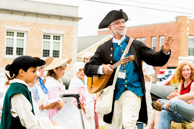 Mike Welch performs with a group of students at the American Independence Museum.