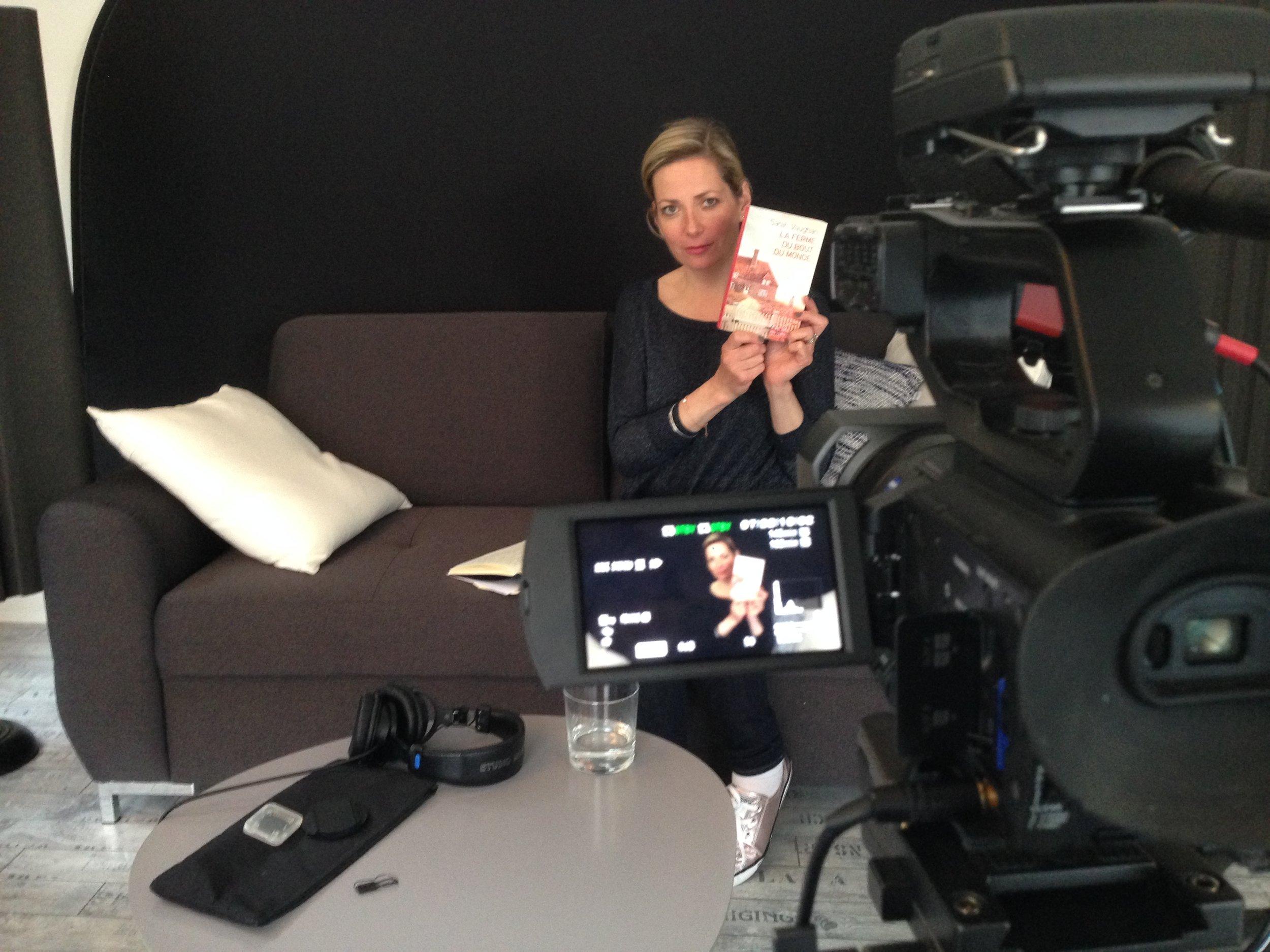 Being filmed discussing La Ferme du Bout du Monde.
