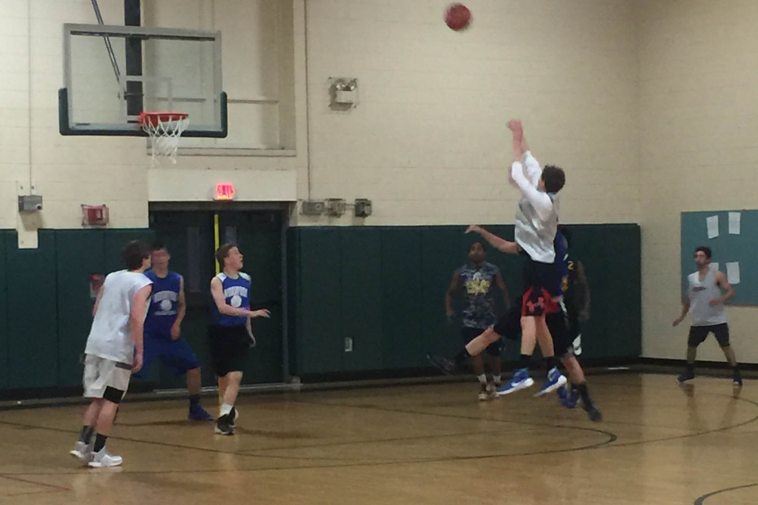 Needham's  Matt McKay  ( NESB-17U  player) takes a jumper from the top of the key vs Norwood.