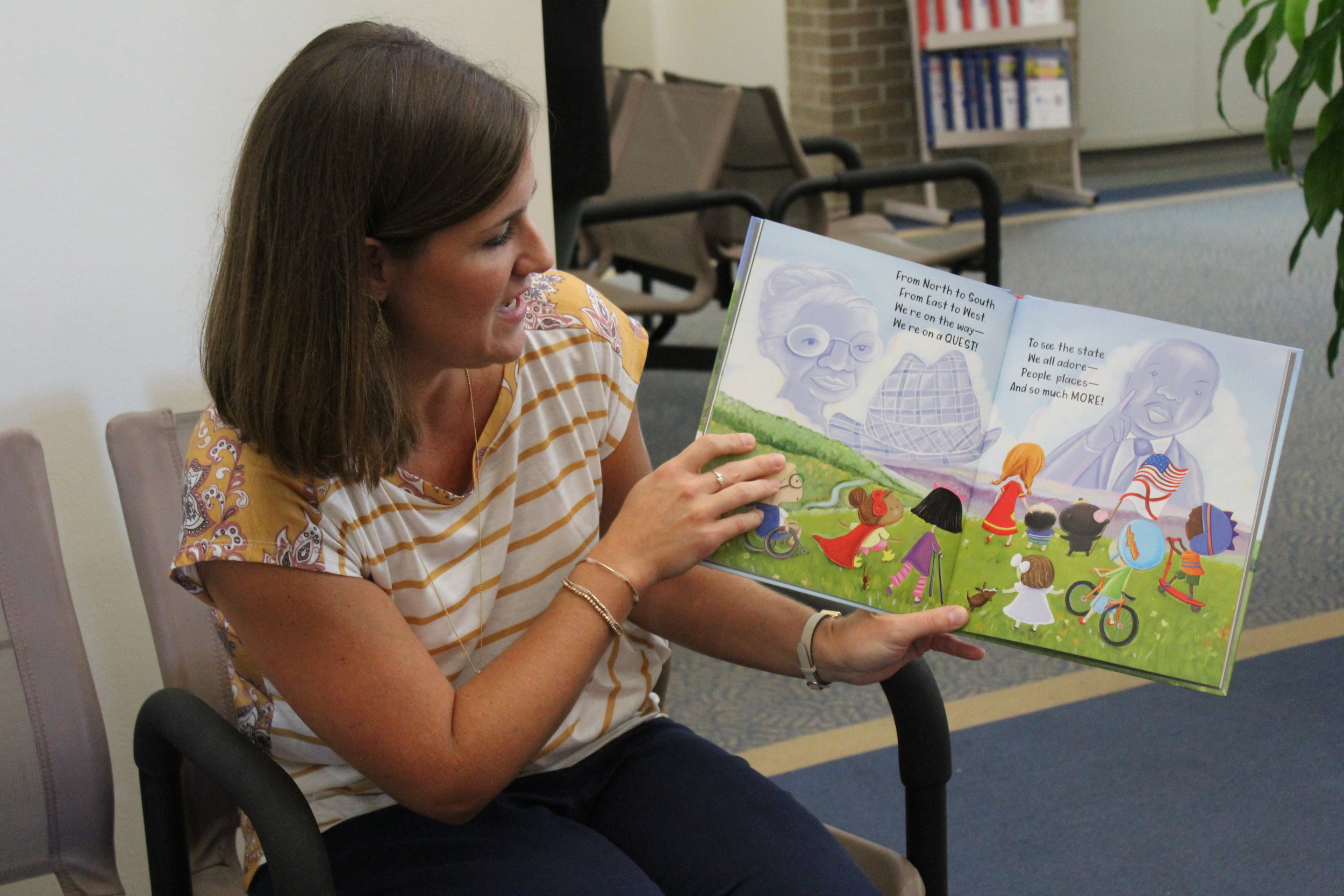 LIndsey fannin, children's librarian at troy public library, read alabama, my home sweet home, to the children in the waiting room