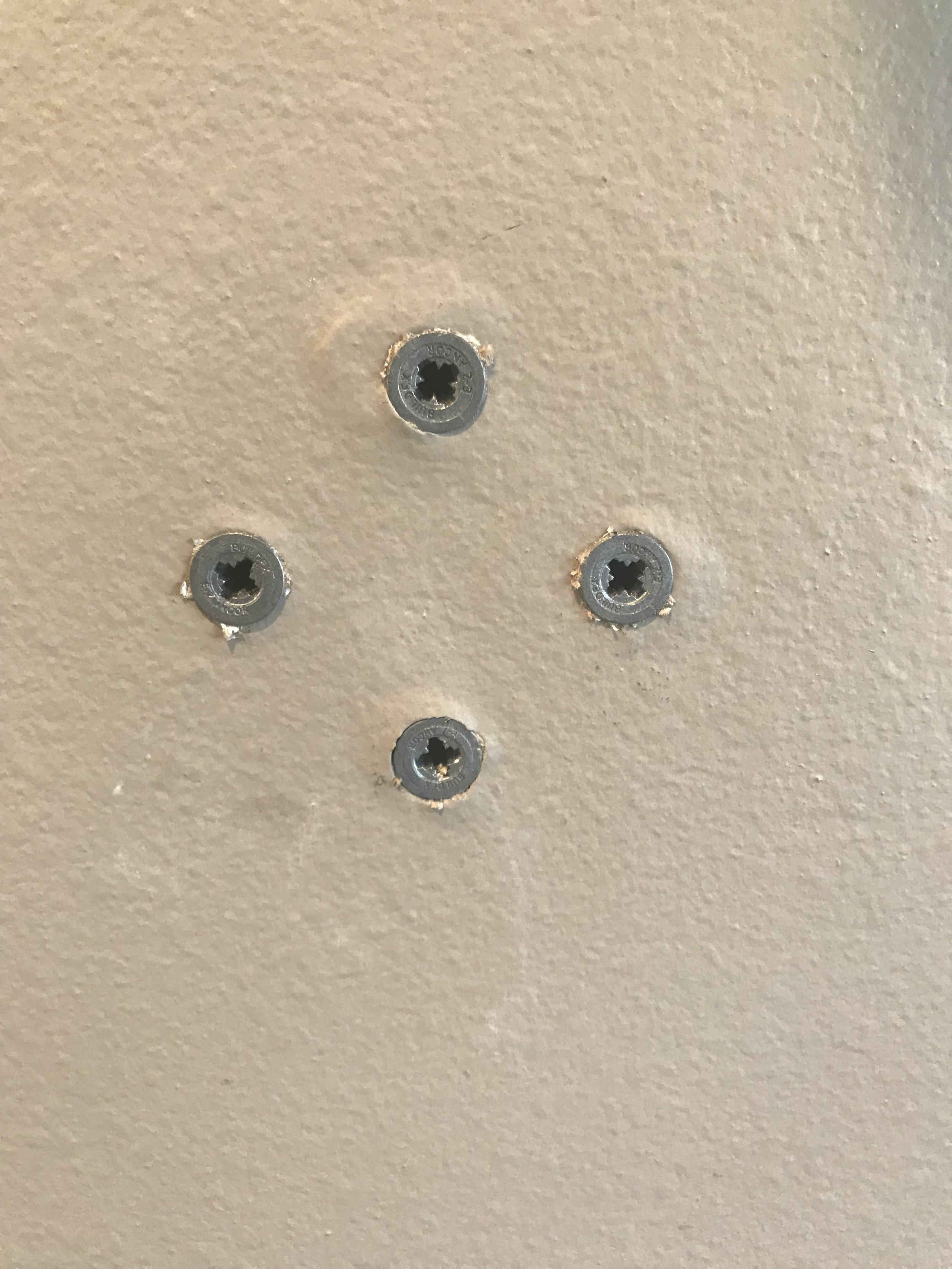 don't over-screw these in… stop when they are flush with the face of the wall.