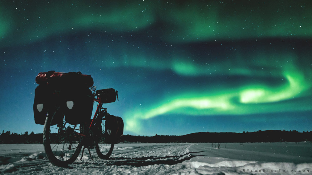 Chebici bike under the northern lights.