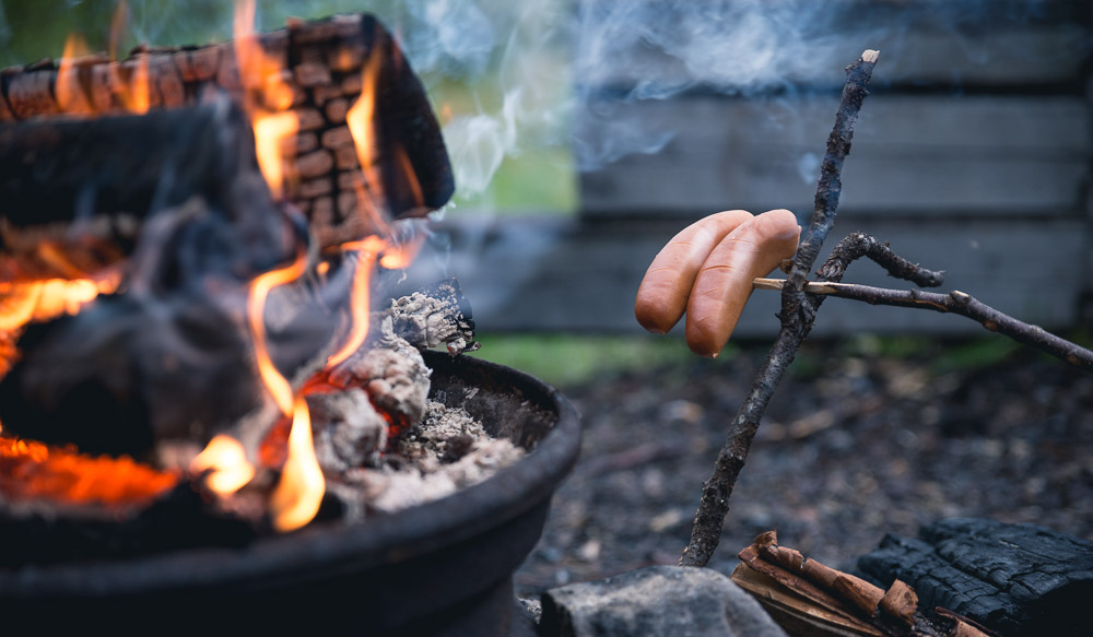 Sometimes I like to pre-cook the sausages by putting them near the fire for 15 minutes. This way they'll cook more evenly from the inside rather than just burning the skin.