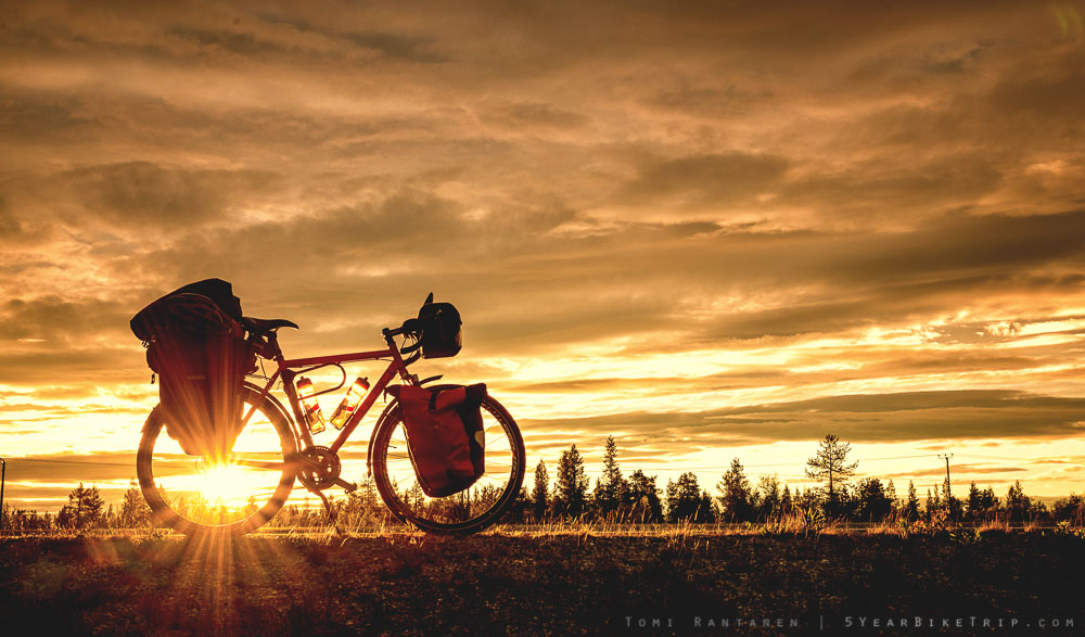 Touring bicycle with the evening sun behind it.