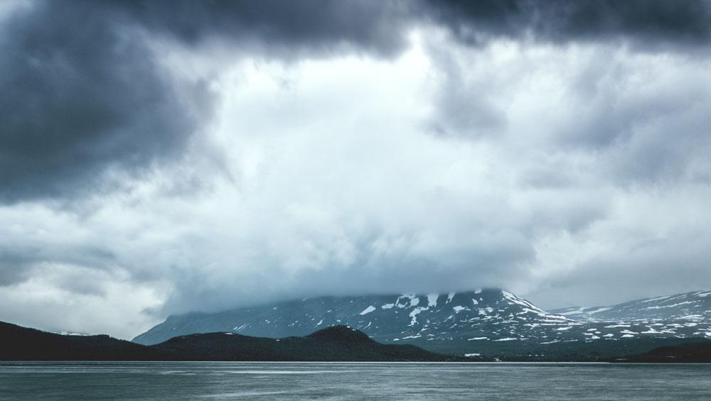 Kilpisjärvi's Saana fell covered by clouds.