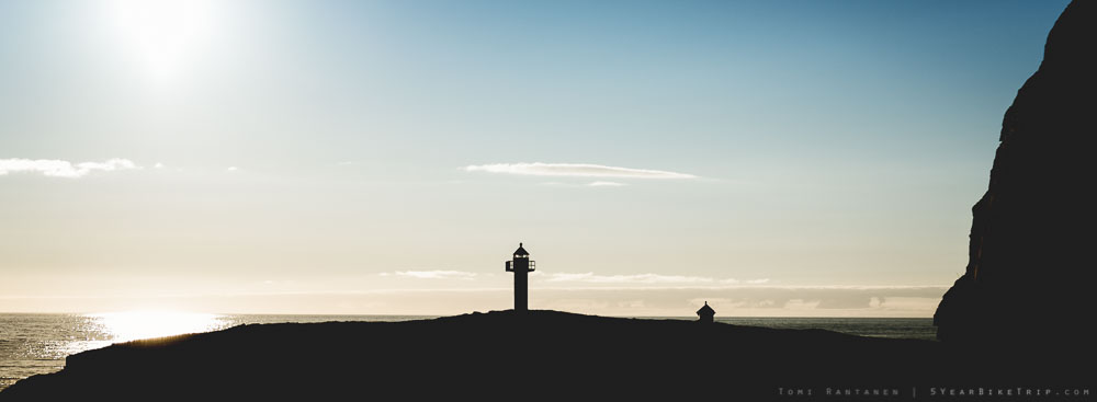 Lighthouse silhouette in Norway.