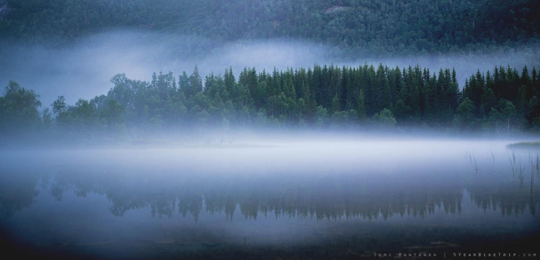Long exposure shot of a foggy lake.