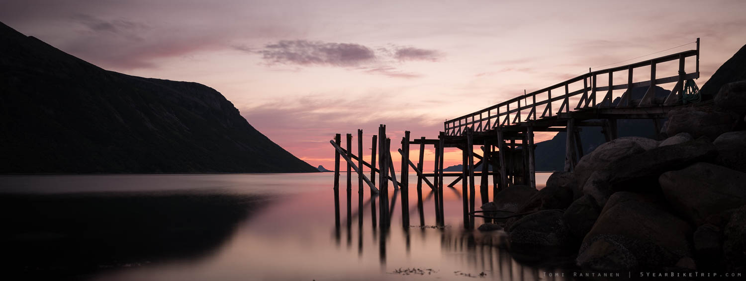 A pier at sunset in a Norwegian fishing village.