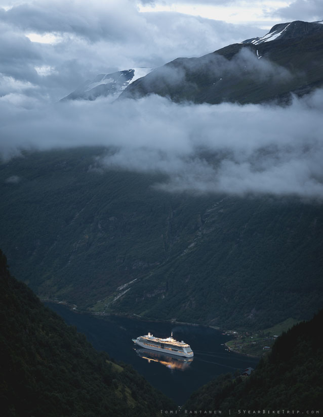 Cruise ship down in the fjord before sunrise.