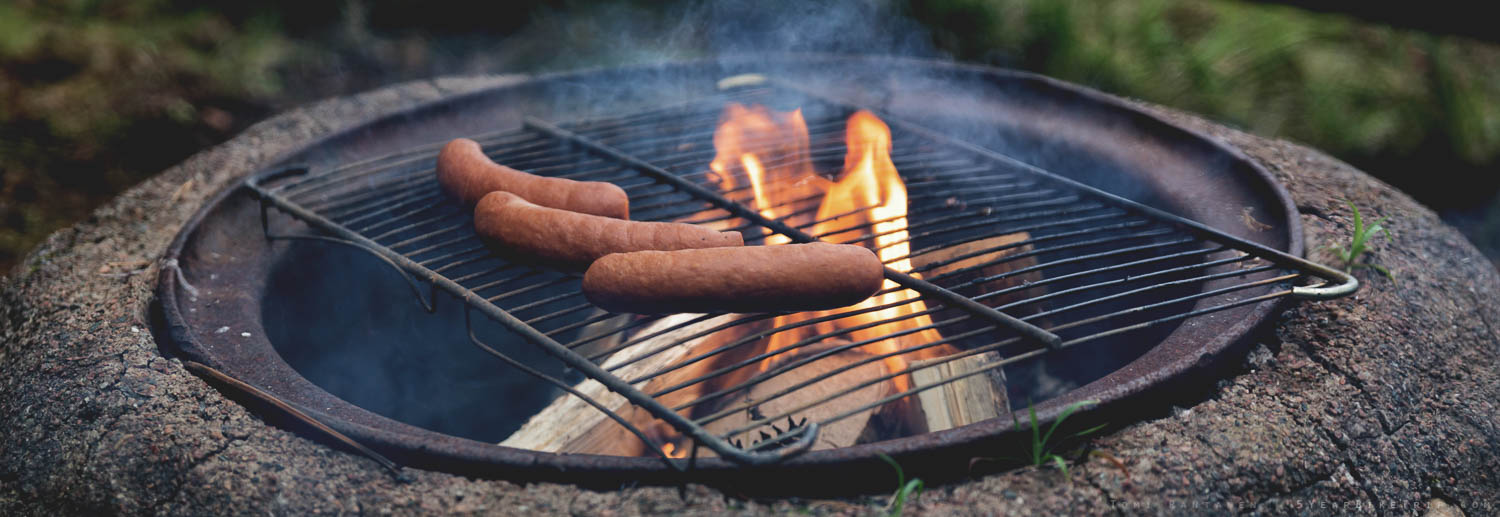 Frying sausages by the fire is a practically mandatory Finnish duty.