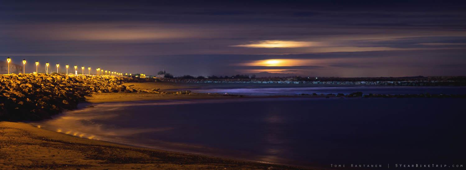 A soft moonrise over the sea.