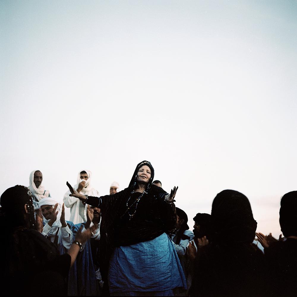 01. Berber woman dancing in the festival of Desert in Mahamid el'Ghizlane, Morocco 2016