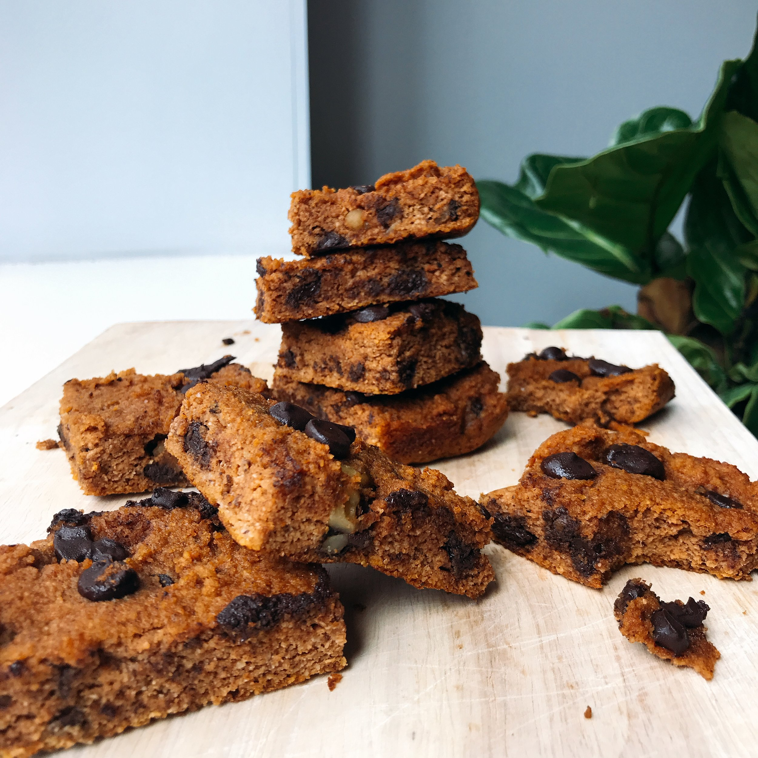 Chewy and fluffy chocolate chip pumpkin blondies! Perfect for the fall, healthy treat or snack. They are dairy free and gluten free!