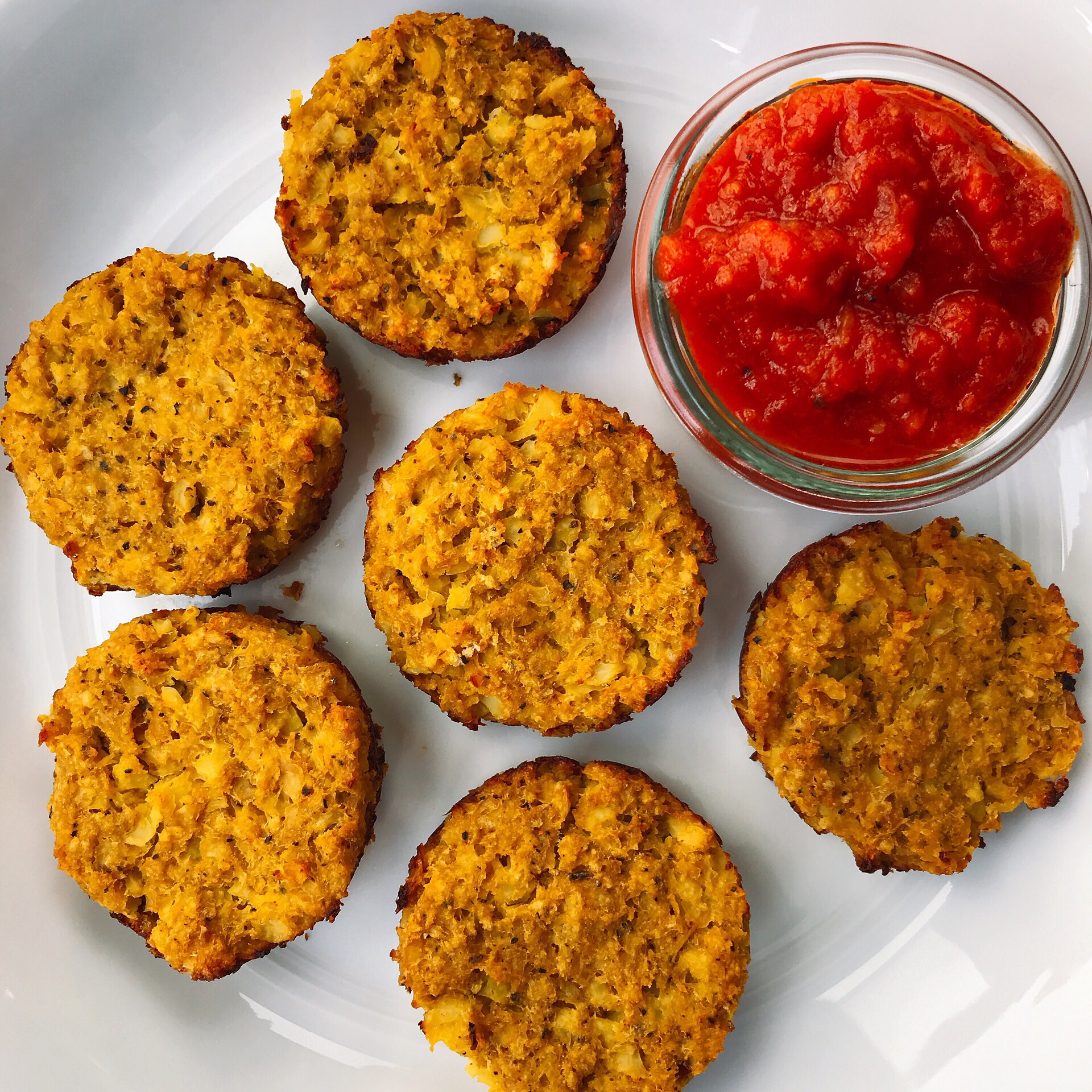 Crispy 'cheesy' cauliflower bites that are completely dairy free, easy to make, and taste like a mix between hash browns and a cauliflower pizza crust. They are so good!