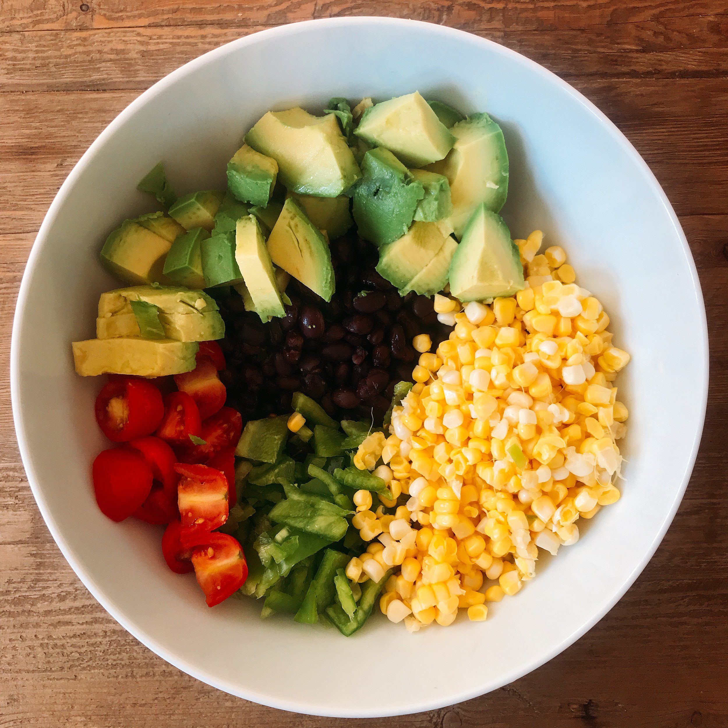 Easy black bean and corn salad! Can be eaten alone or used as a dip!