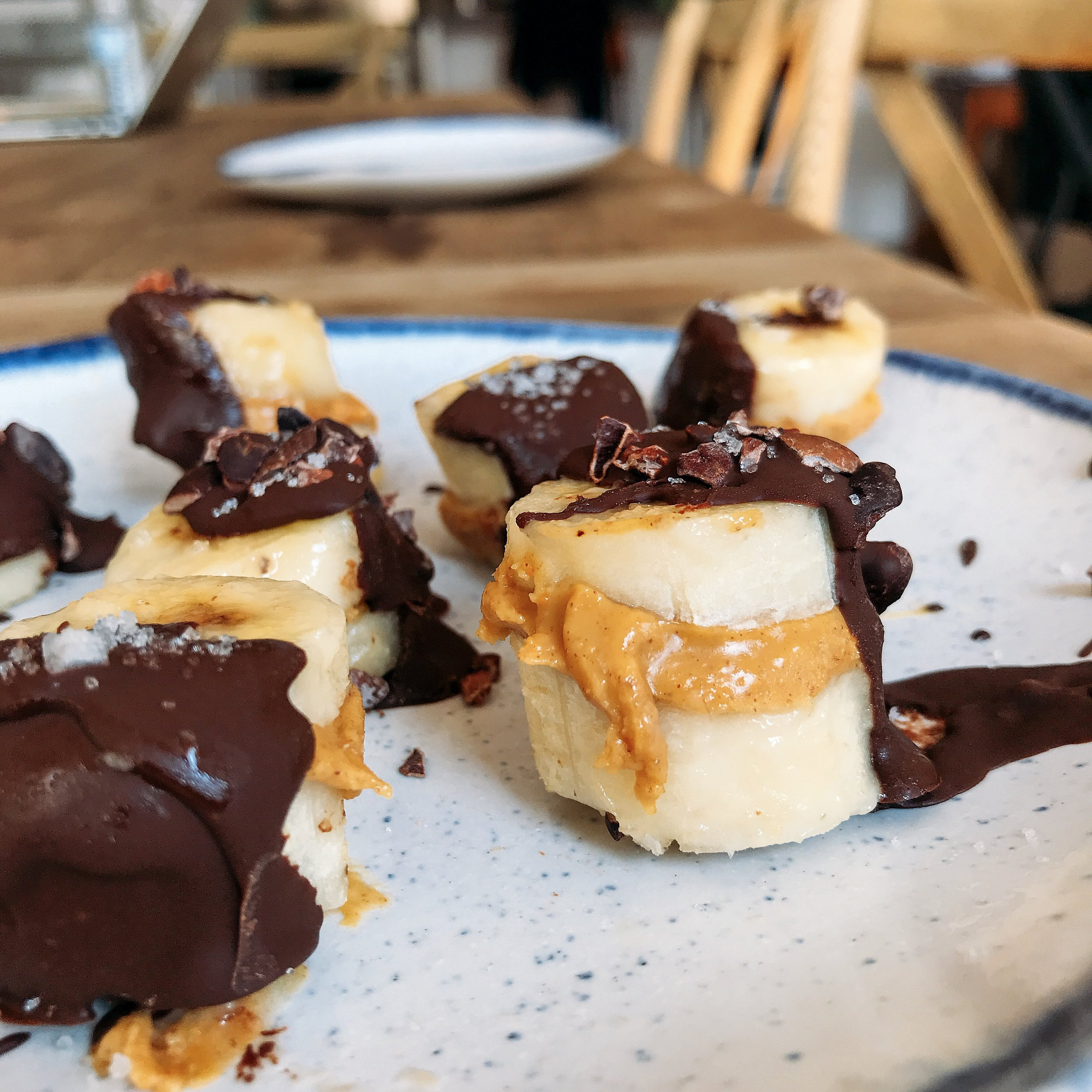 These chocolate peanut butter filled banana bites are super simple to make. Best right out of the freezer for a healthy treat.