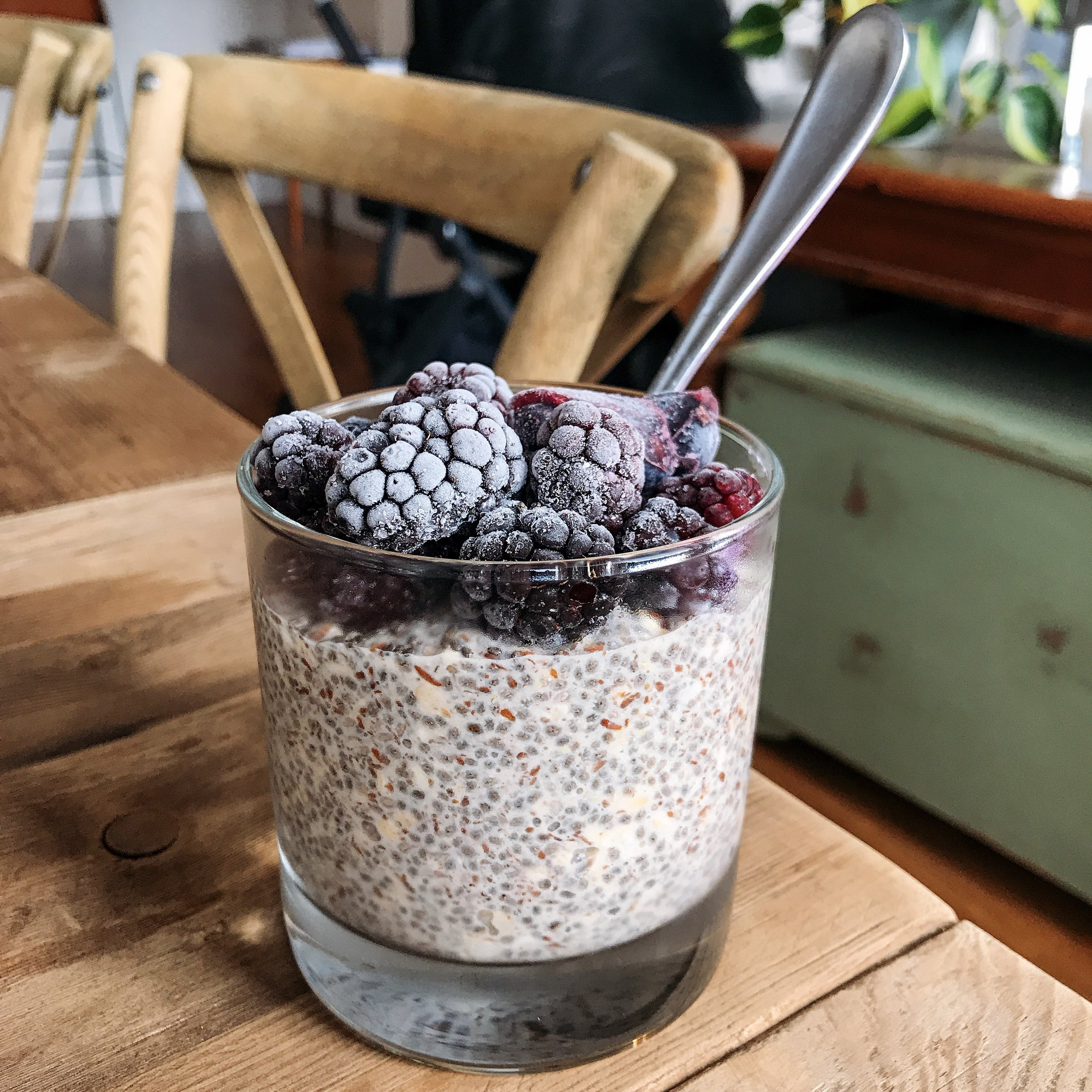 Berry chia pudding topped with frozen blackberries, blueberries, and coconut butter!