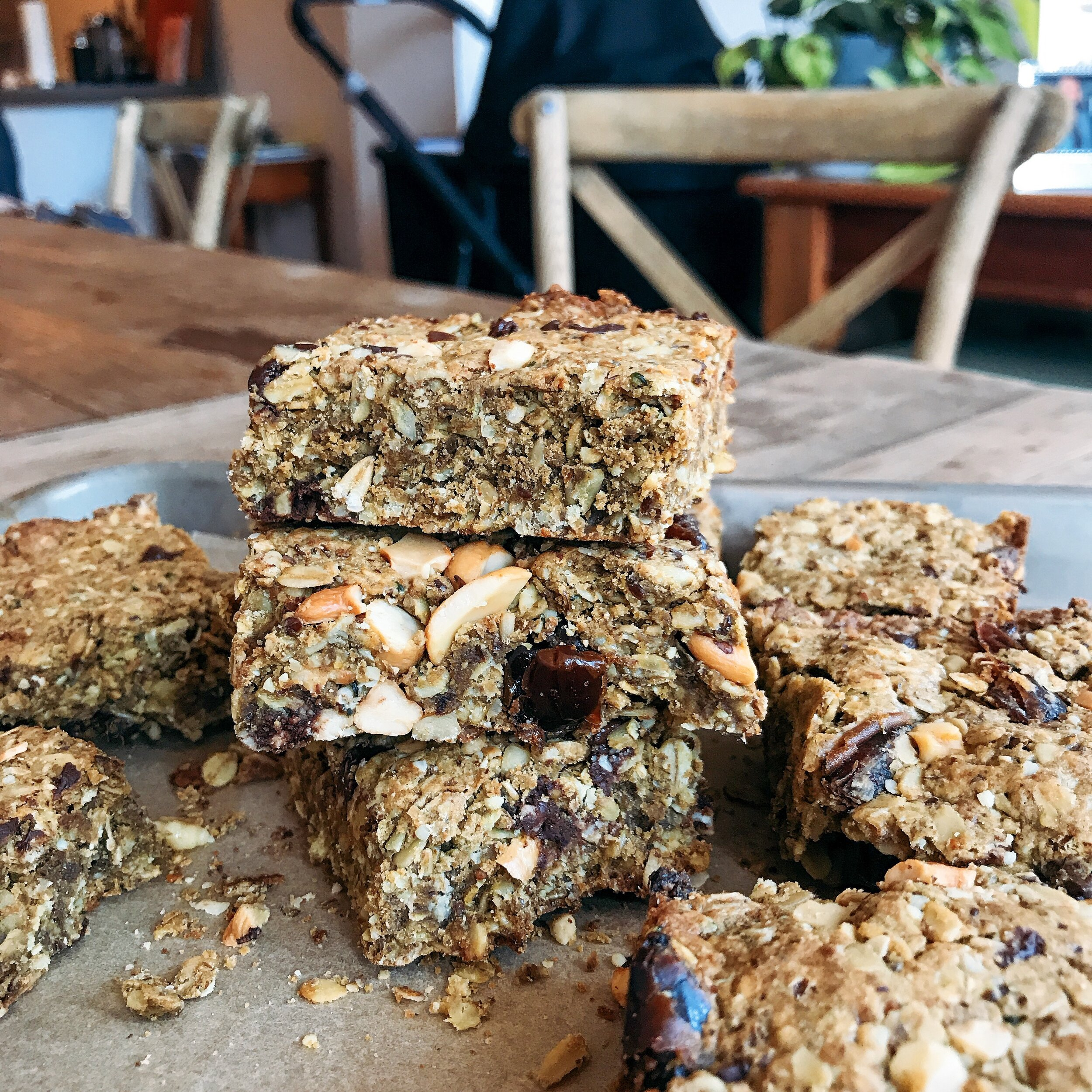 Crunchy granola bars that are filled with dates, nuts, oatmeal, and chocolate chips that are perfectly healthy for a breakfast on the go or mid afternoon treat - they even have a lactation boost for anyone who is nursing!