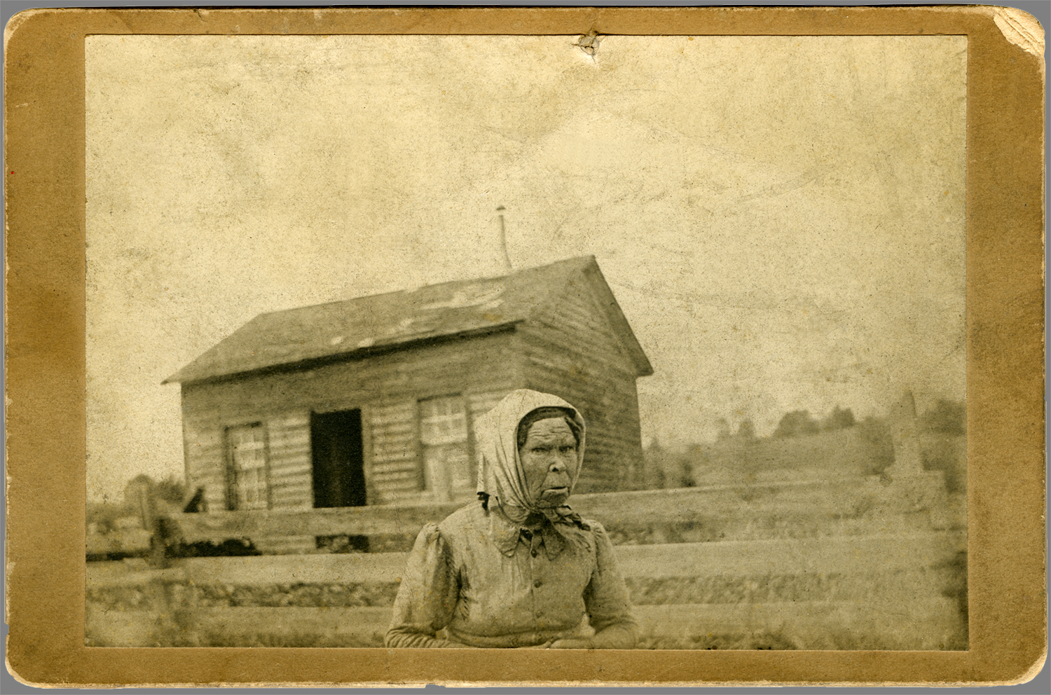 """Old Mrs. Maden, her home on the Waterford road 1 mile west of Union City. 1889"""
