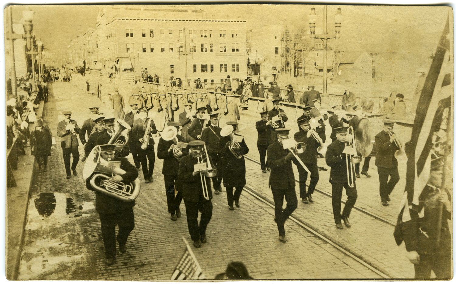 "Printed as a photo postcard. ""Peace Day at Salamanca NY. Nov. 11, 1918. Was playing one of your old favorites ""Bombasto"" when this was snapped. Best Regards."""