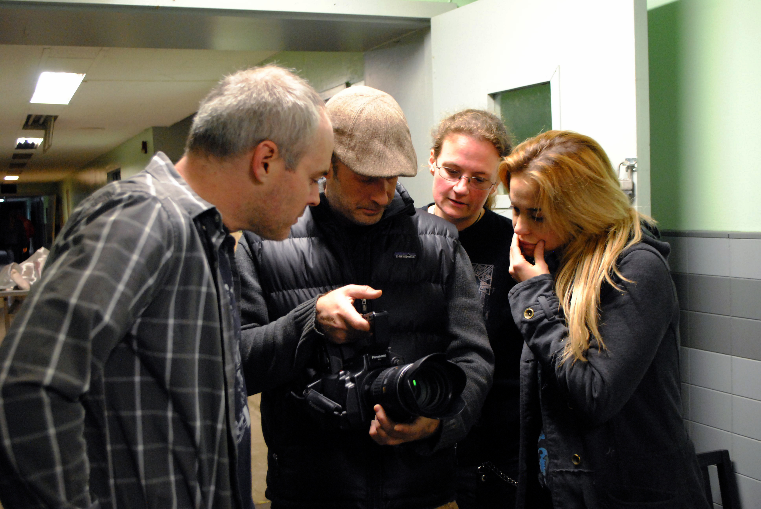 The co-directors go over a scene with the gaffer, Jim Kunz, and the cinematographer Brian Davis.   Photo by Amanda Duchow.