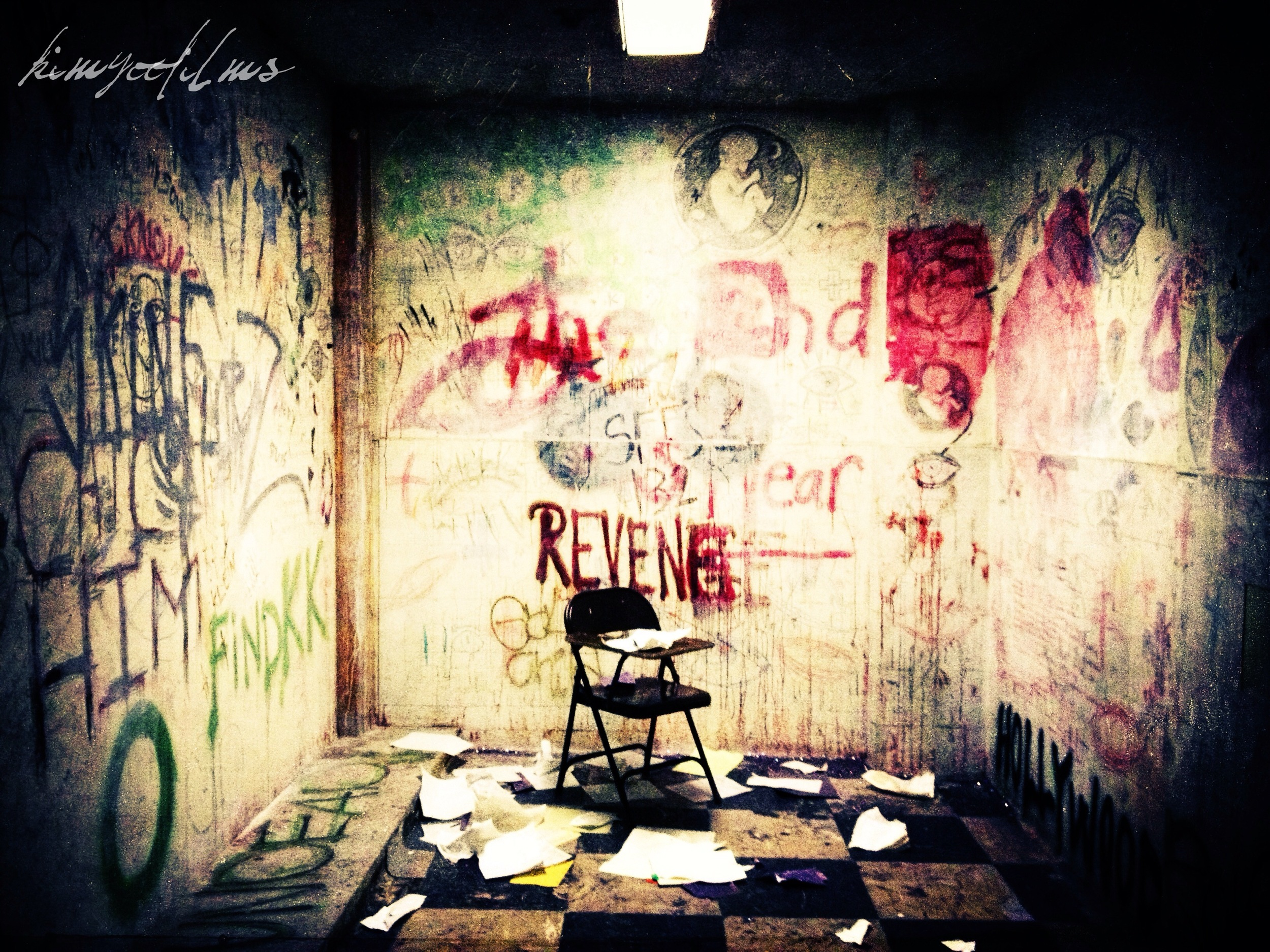 Creepy graffiti room.