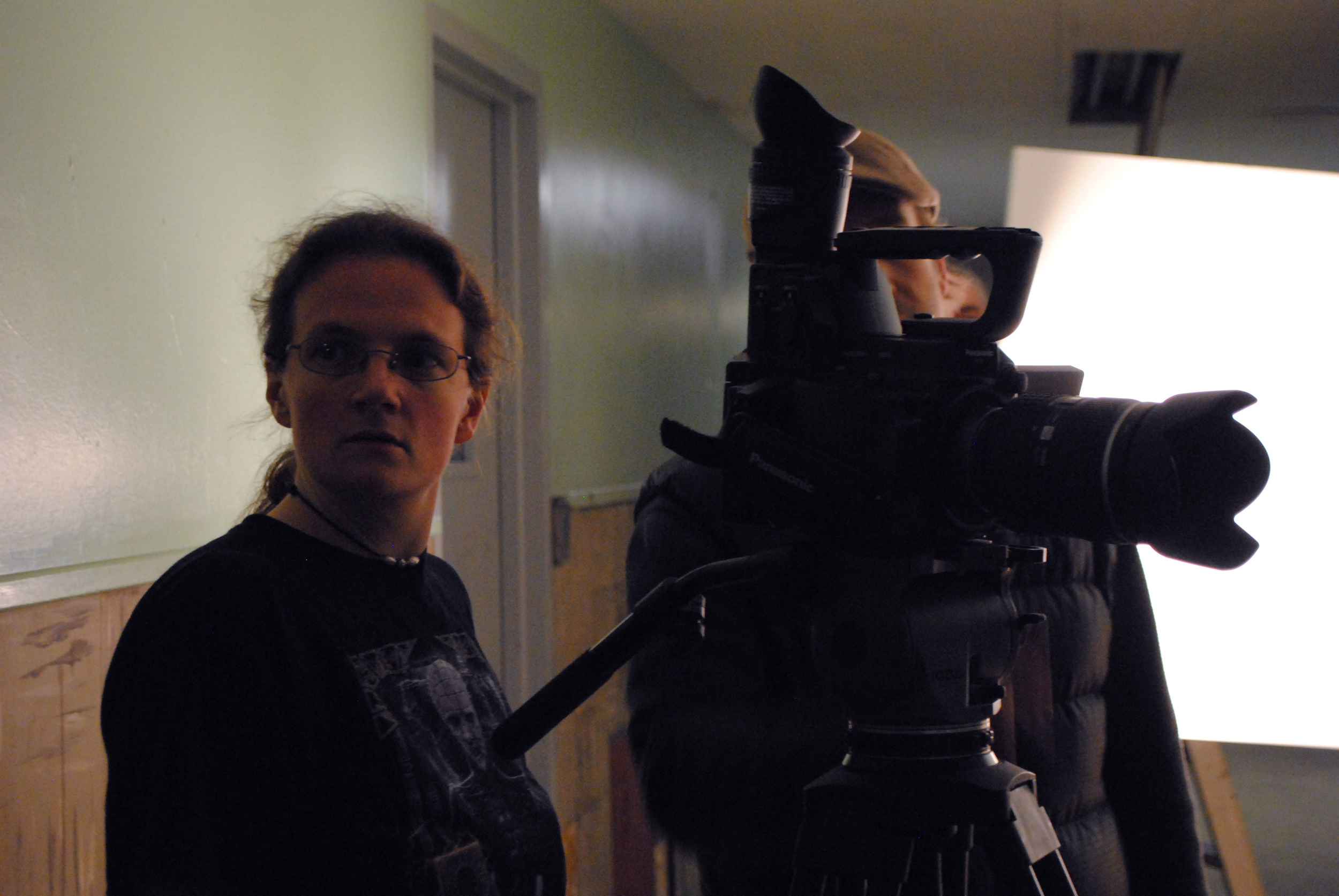 Co-director Lori Bowen is listening intently to an actor's question.