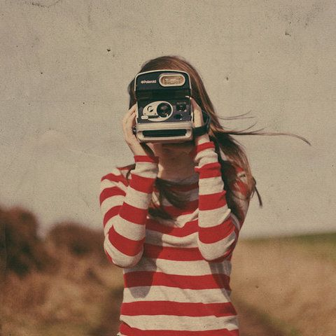 young girl with polaroid.jpg