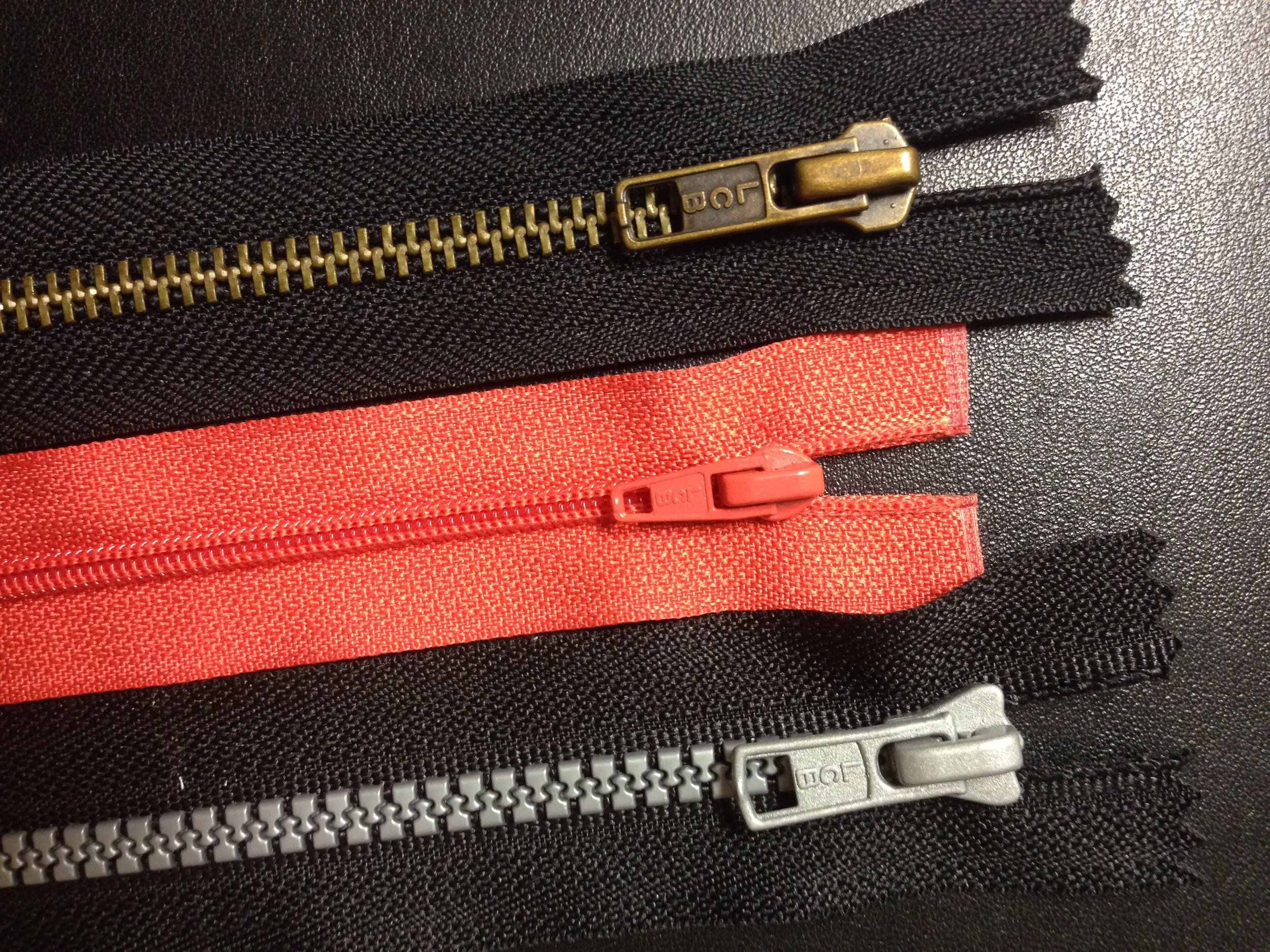 Zippers now have a variety of stylings, including metal teeth (top), coil teeth and plastic teeth.  By Woodbine9 - Own work, CC BY-SA 4.0, https://commons.wikimedia.org/w/index.php?curid=36746452