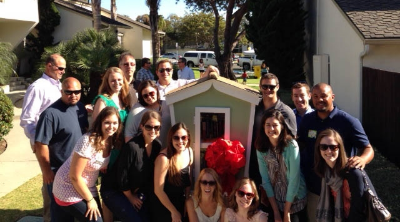 The Leadership Santa Barbara County Class of 2013 in front of one of the Little Outdoor Libraries they helped construct with partner, Housing Authority of the City of Santa Barbara.