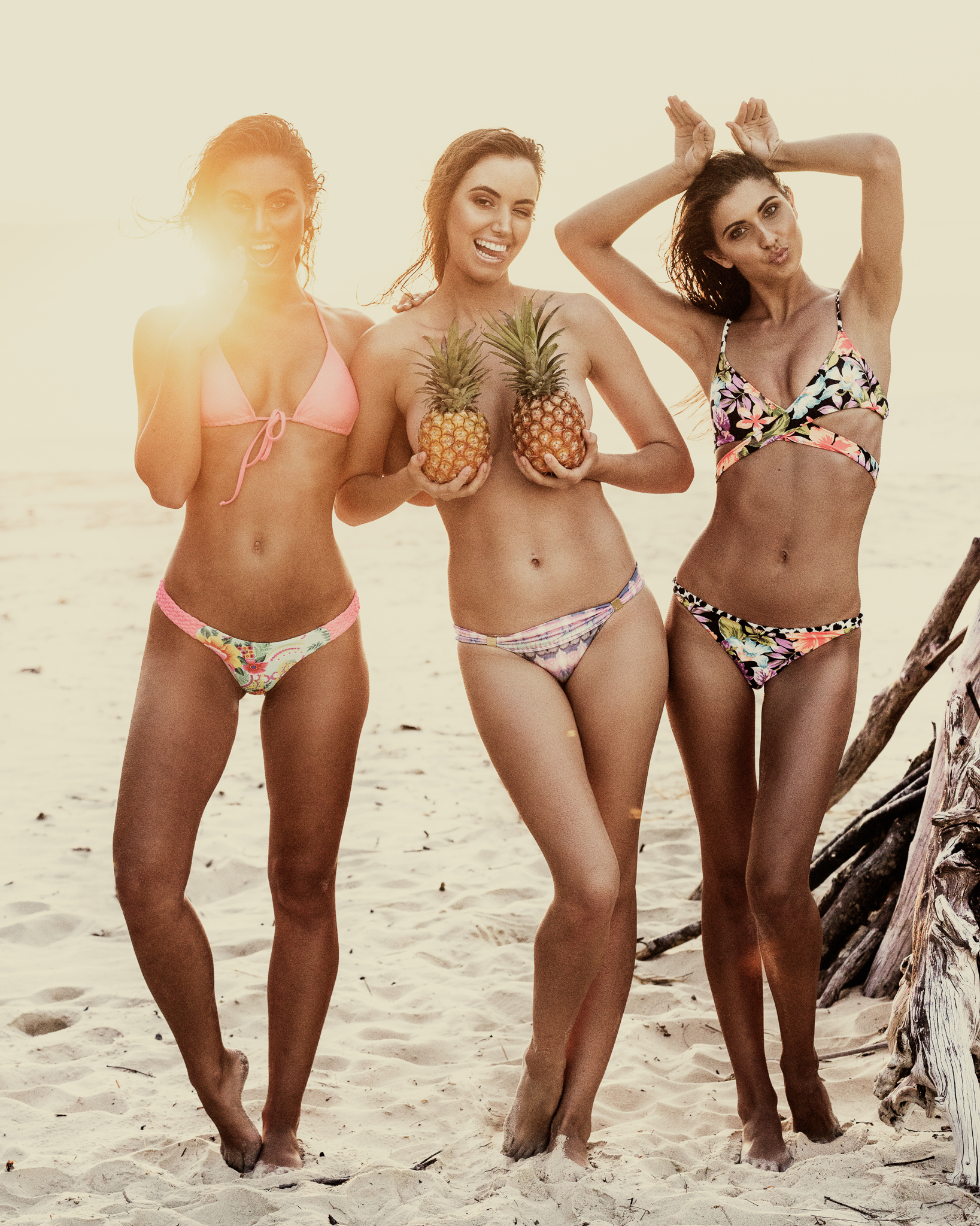 Postcards From Paradise. - What's to say when you come across an abandoned tee-pee on an Island beach, at sunset, with three models and a couple of good looking pineapples. Steph Rayner, Bridget McMahon, Lori McKenzie via Vivien's Models; Photographs by Dave Blake, Hair-Makeup Jessica Cagney. Location: North Stradbroke Island, Queensland Australia.