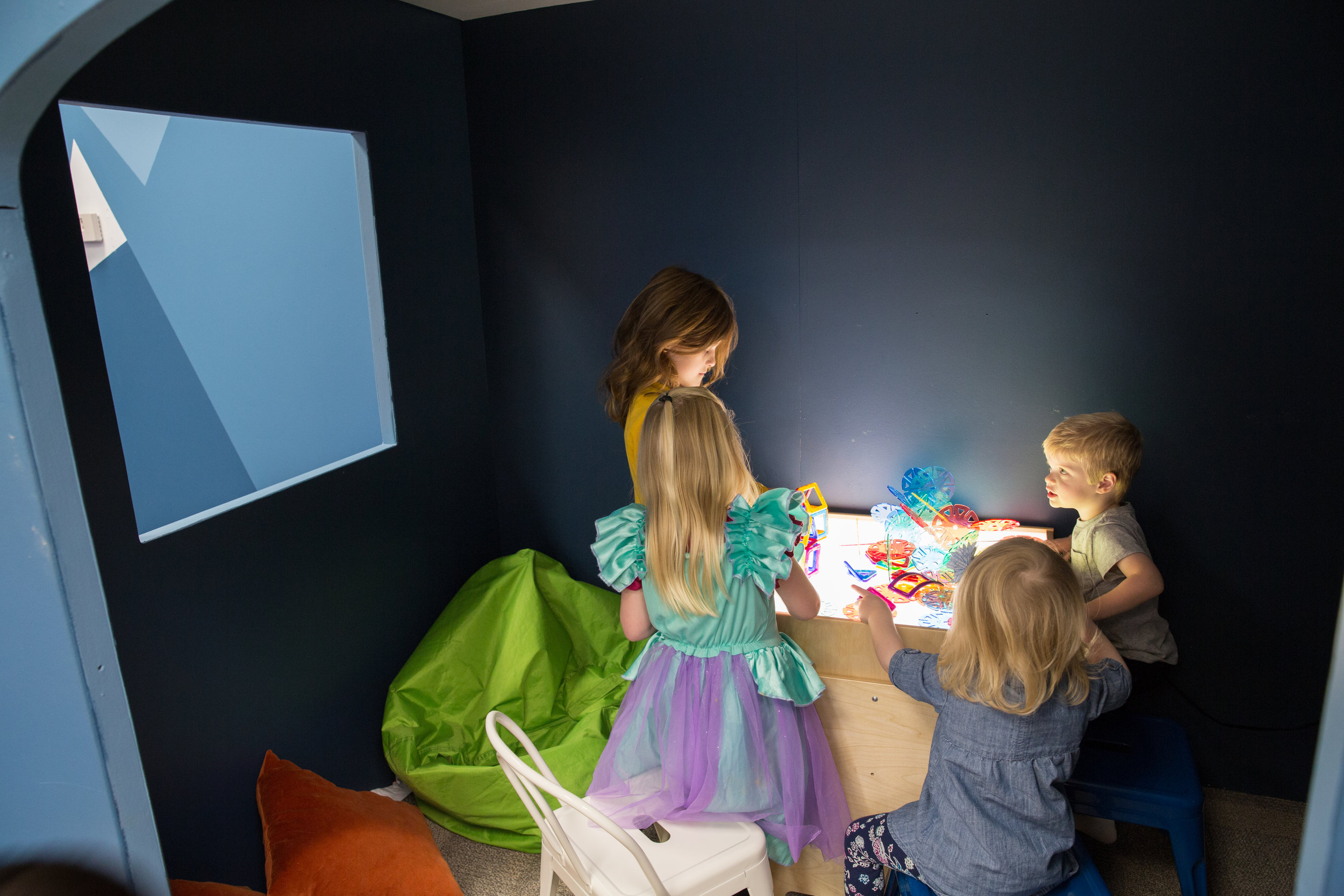 Dark room - We've built a calming dark cave for when the kids are overstimulated or want to play on the light table