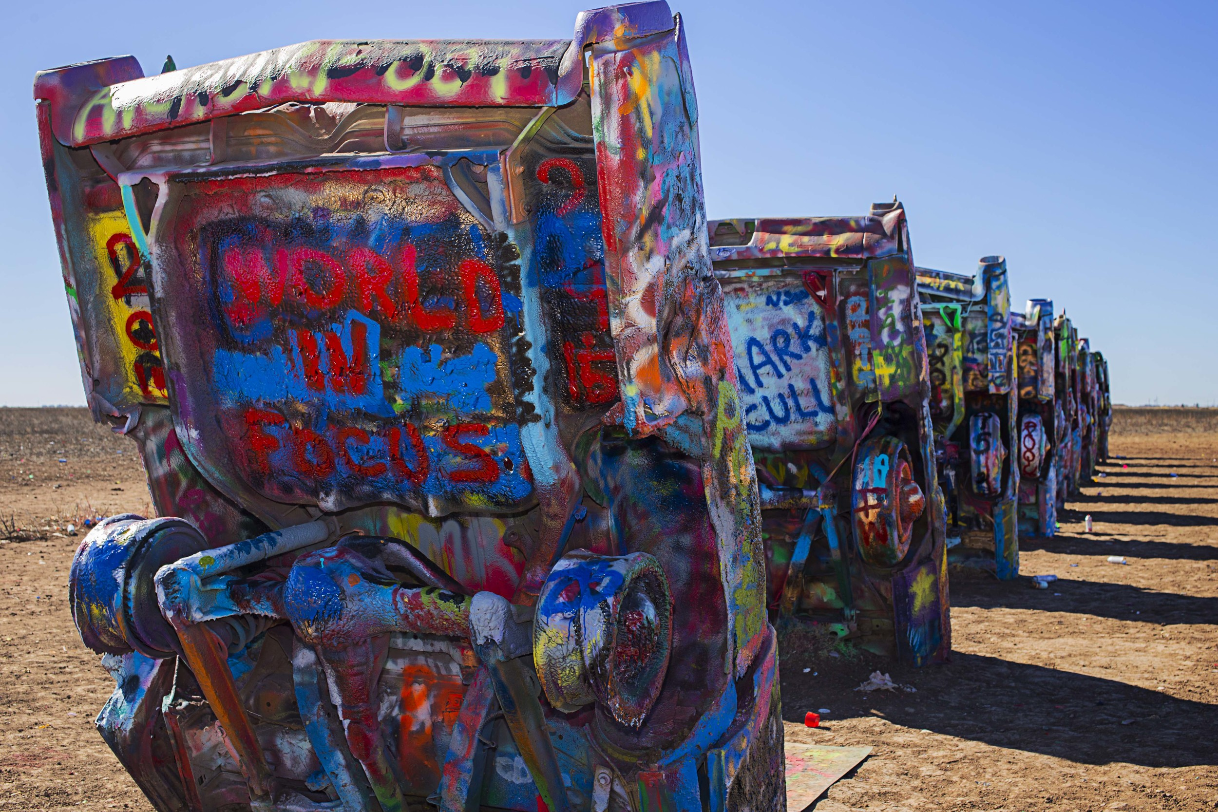 Day 17 - Amarillo, TX  We couldn't pass up a chance to stop by Cadillac Ranch on our way to Santa Fe, NM.  Here you will find literally old Cadillacs buried into the ground where you are encouraged to express yourself.  Don't mind if we do!