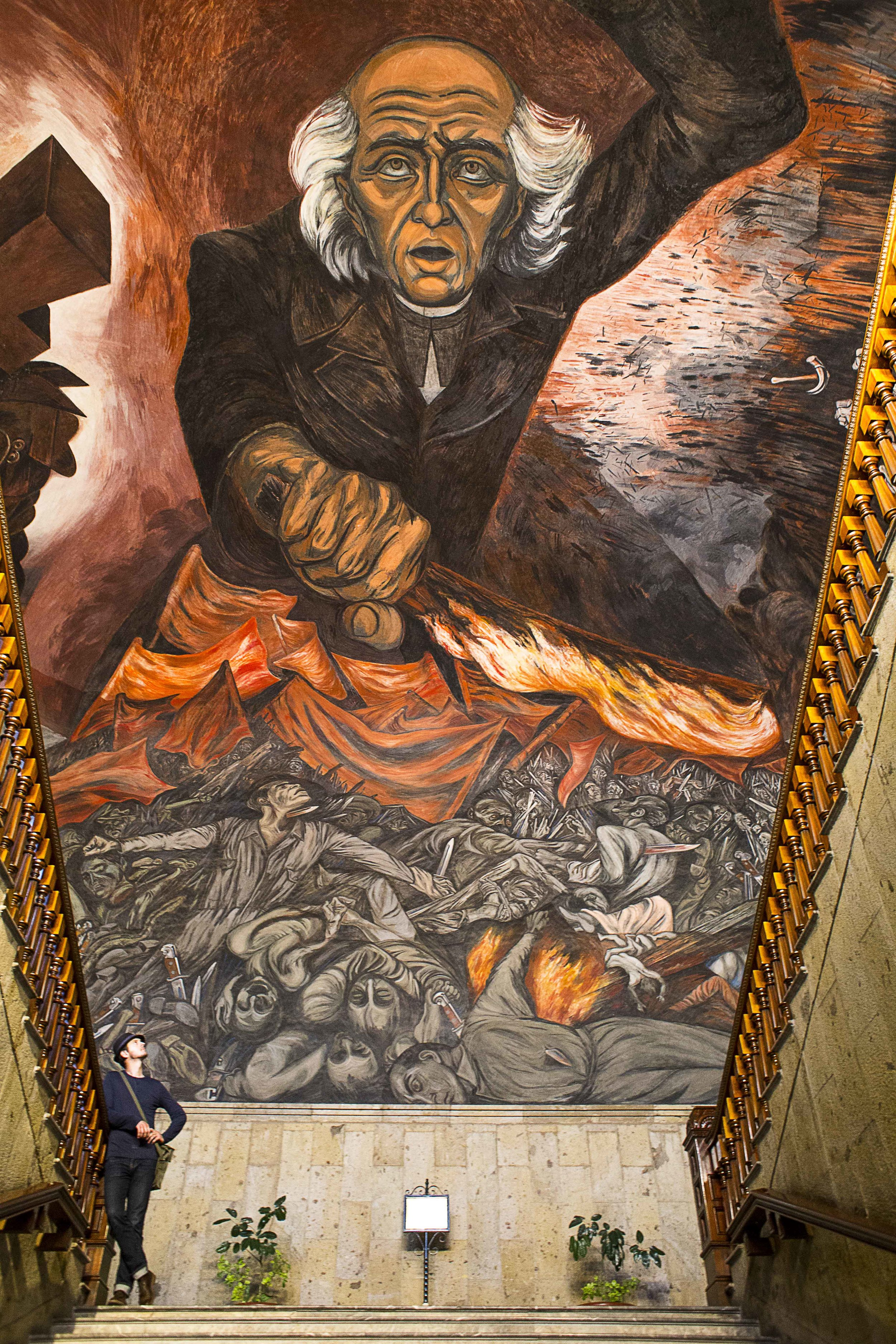 Day 65 - Guadalajara, Jalisco, Mexico   A mural by famed artist Jose Clemente Orozco showing Miguel Idalgo, the father of the Mexican Independence, brandishing a fiery torch at shadowy figures representing oppression and slavery. Painted in 1937 inside the Goernor's Palace or  Palacio del Govierno,  at the main staircase.