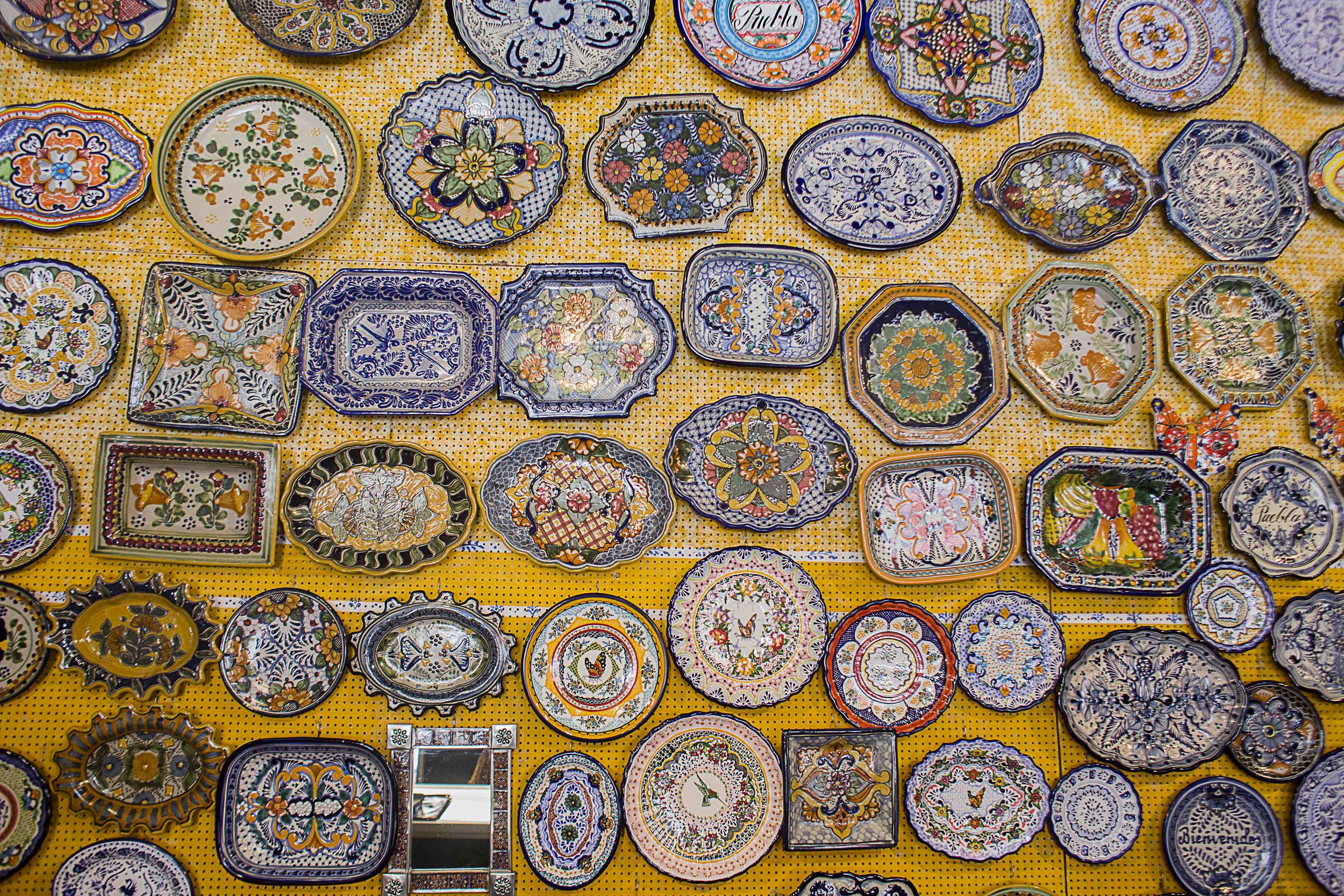 Day 99 - Puebla, Puebla, Mexico   A Talavera shop showcasing their many plates and designs.