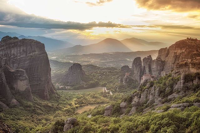 The clouds finally dispersed and the sun made a cameo just on time to evenly lit the valley and reveal two of the monasteries perched on the cliffs of Meteora.  This area lived up to its reputation and I was pleasantly surprised that there were only of couple of us patiently waiting for the sun to arrive.  #bestvacations #greece #instagood #instagramhub #photography #photooftheday #iger #igphotooftheday #canonphotography #worldphoto #landscapephotography #documentary #documentaryphotography #instagram #worldinfocus #nature #roadtrip  #adventure #canon6d #travelphotography #sunrise #outdoors #mountains #free#freedom