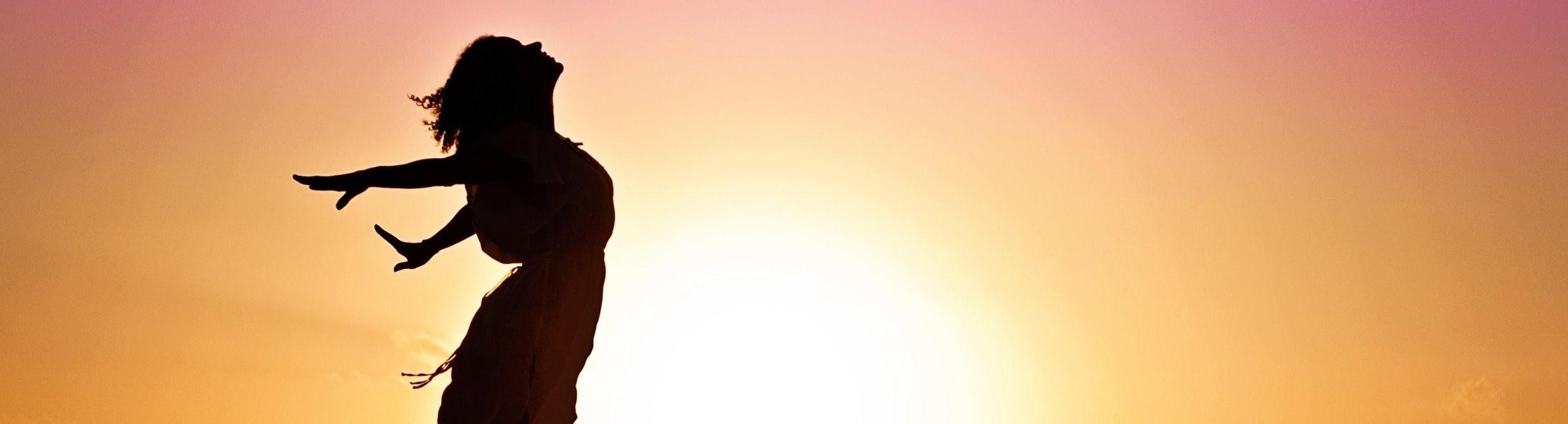 woman-happiness-sunrise-silhouette-40192.jpeg
