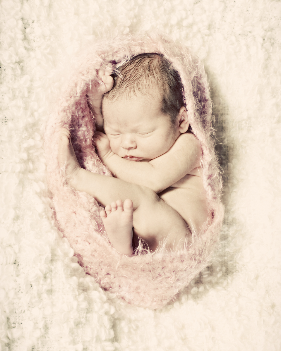 Snuggly newborn baby photography