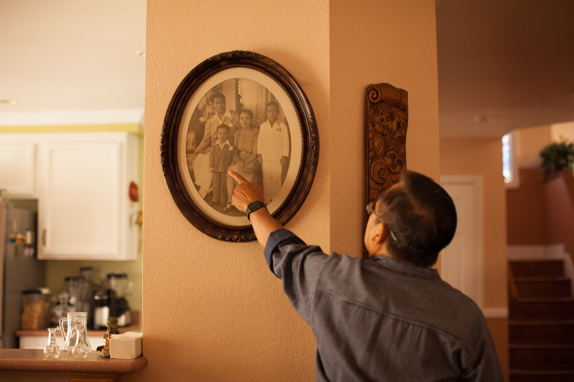 Manolo Guerra points out himself in an old family portrait at his home in Moreno Valley, California, Wednesday, Aug. 7, 2019. (Photo/ Kat Kaye)