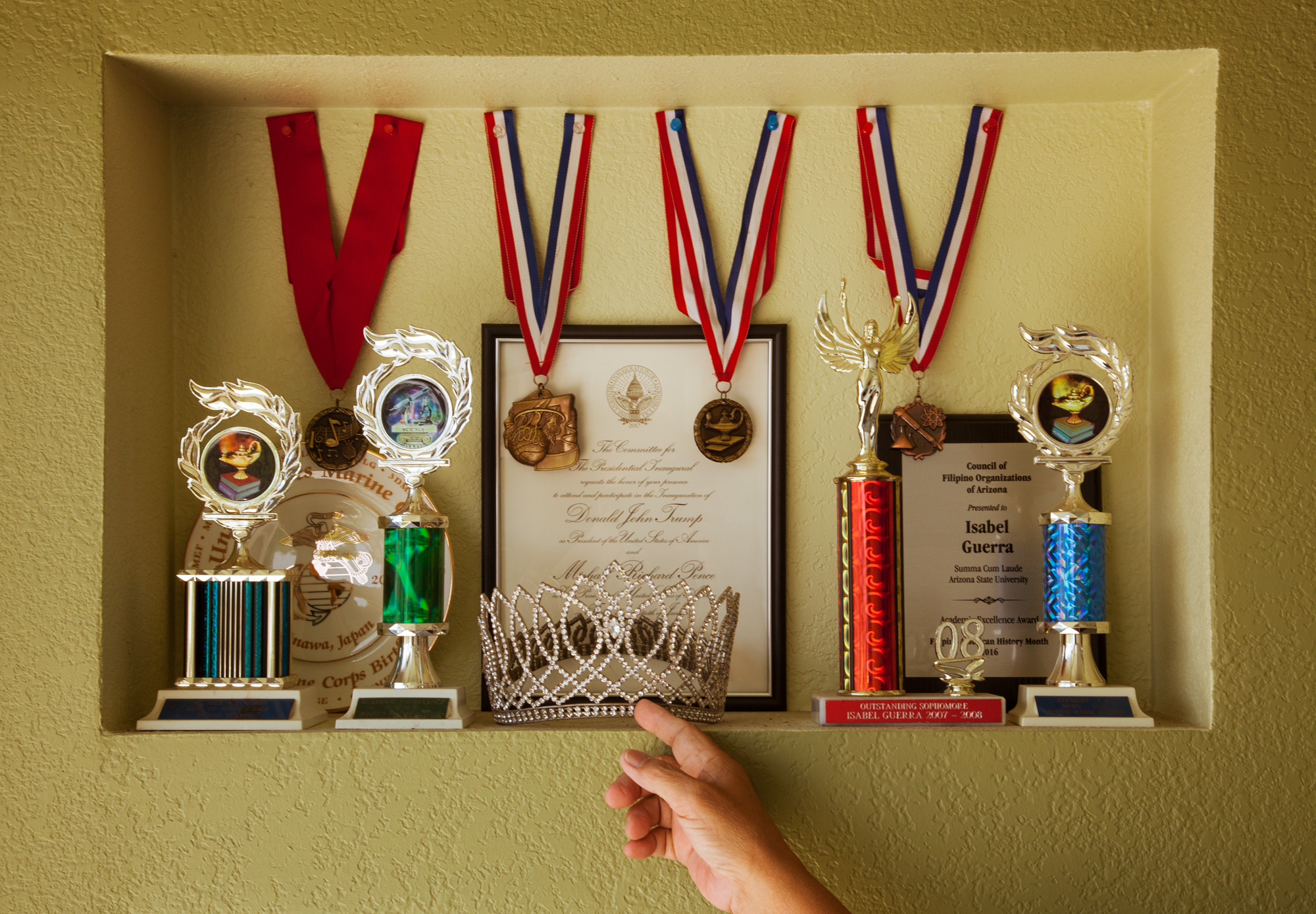 Trophies and ribbons won by the Guerra sisters in the garage of Manolo Guerra in Moreno Valley, California, Wednesday, Aug. 7, 2019. (Photo/ Kat Kaye)