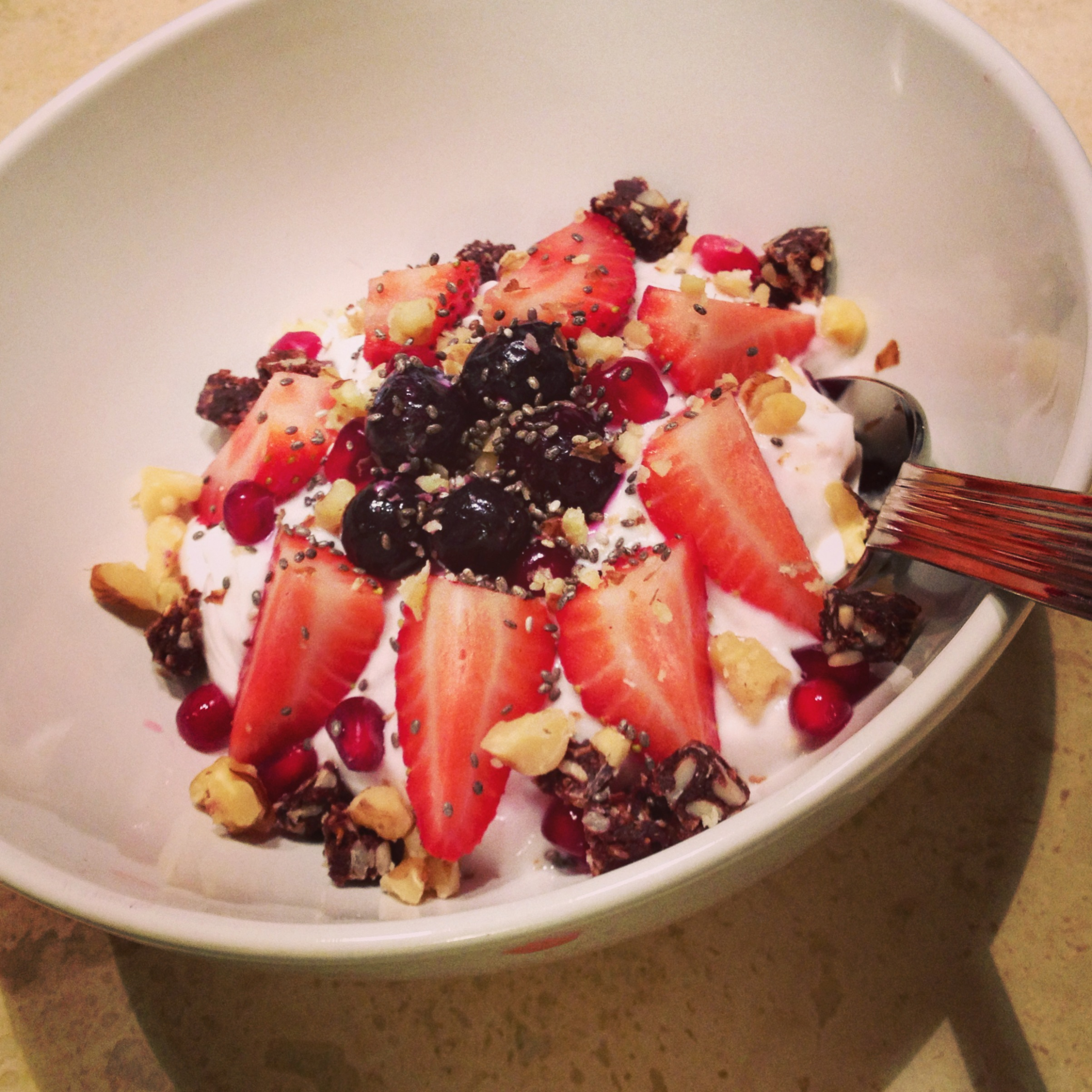 1 cup non-fat greek yogurt, fresh strawberries, blueberries, pomegranate seeds, chopped walnuts, chia seeds.