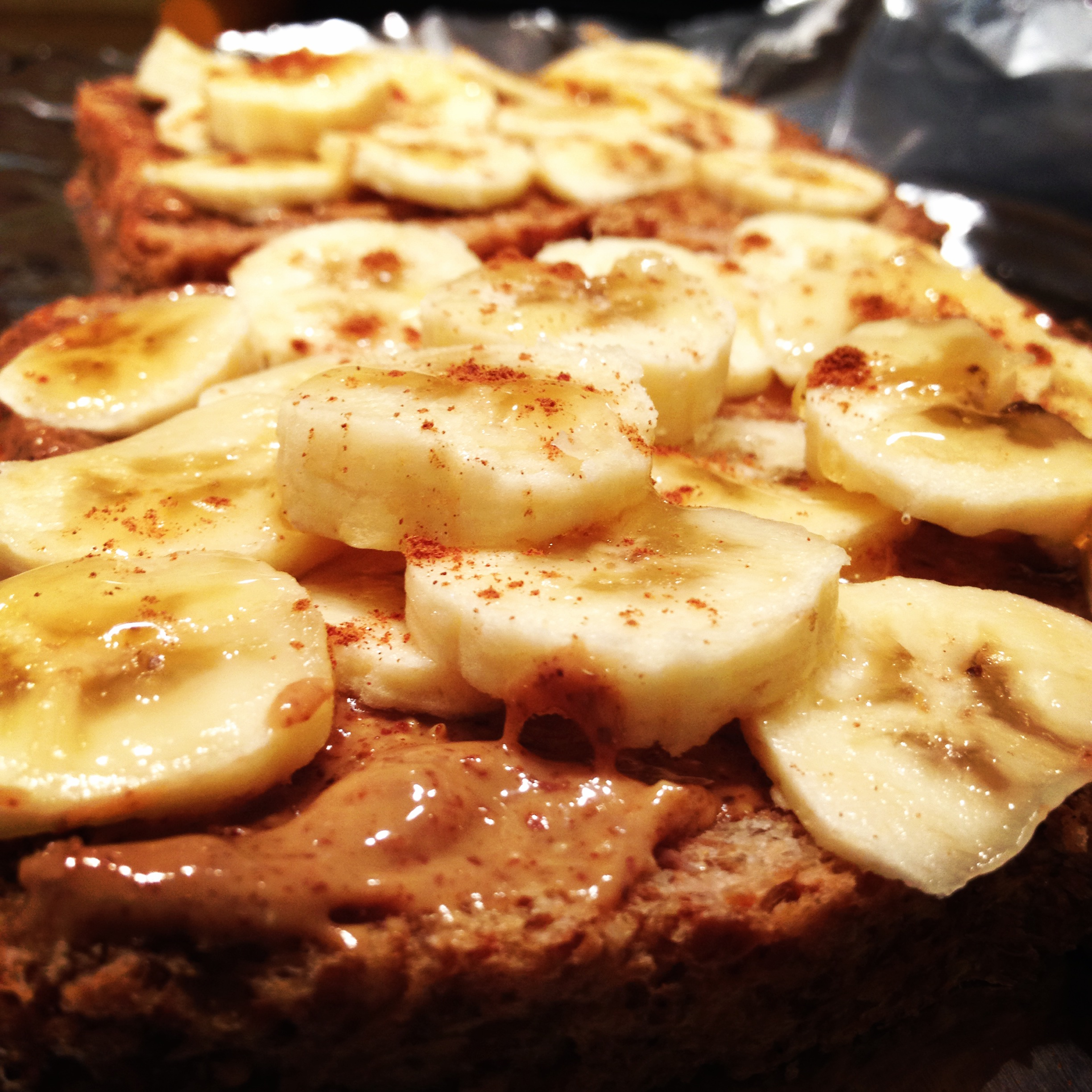 Toasted Ezekiel bread, almond butter, sliced banana, cinnamon sprinkle. (My go-to pre-race fuel!)