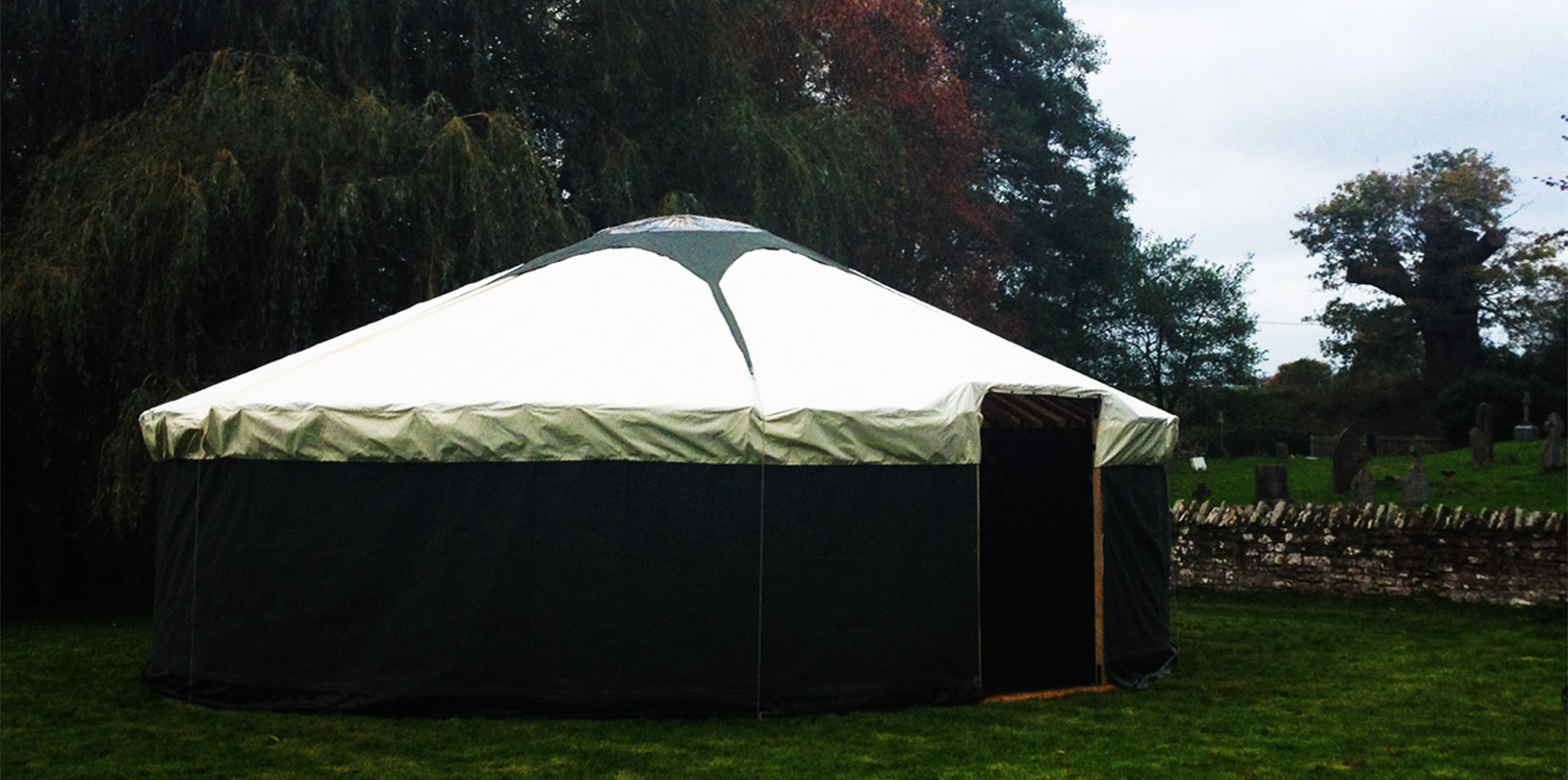 30ft yurt with green walls.