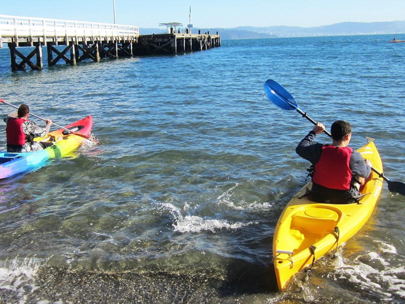 3x4 small kayaks setting out from beach.jpg