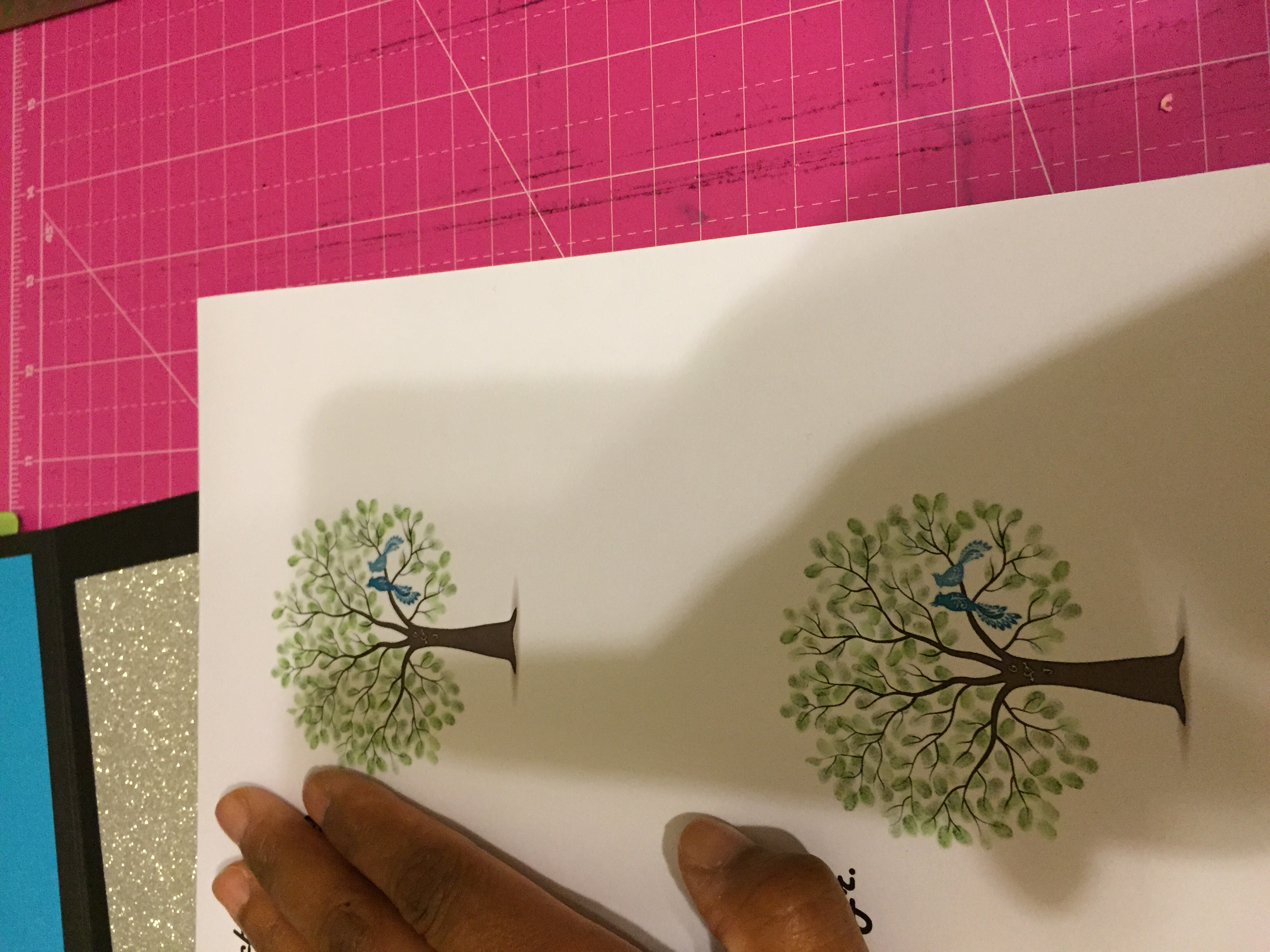 Tree graphic with 2 little birdies.